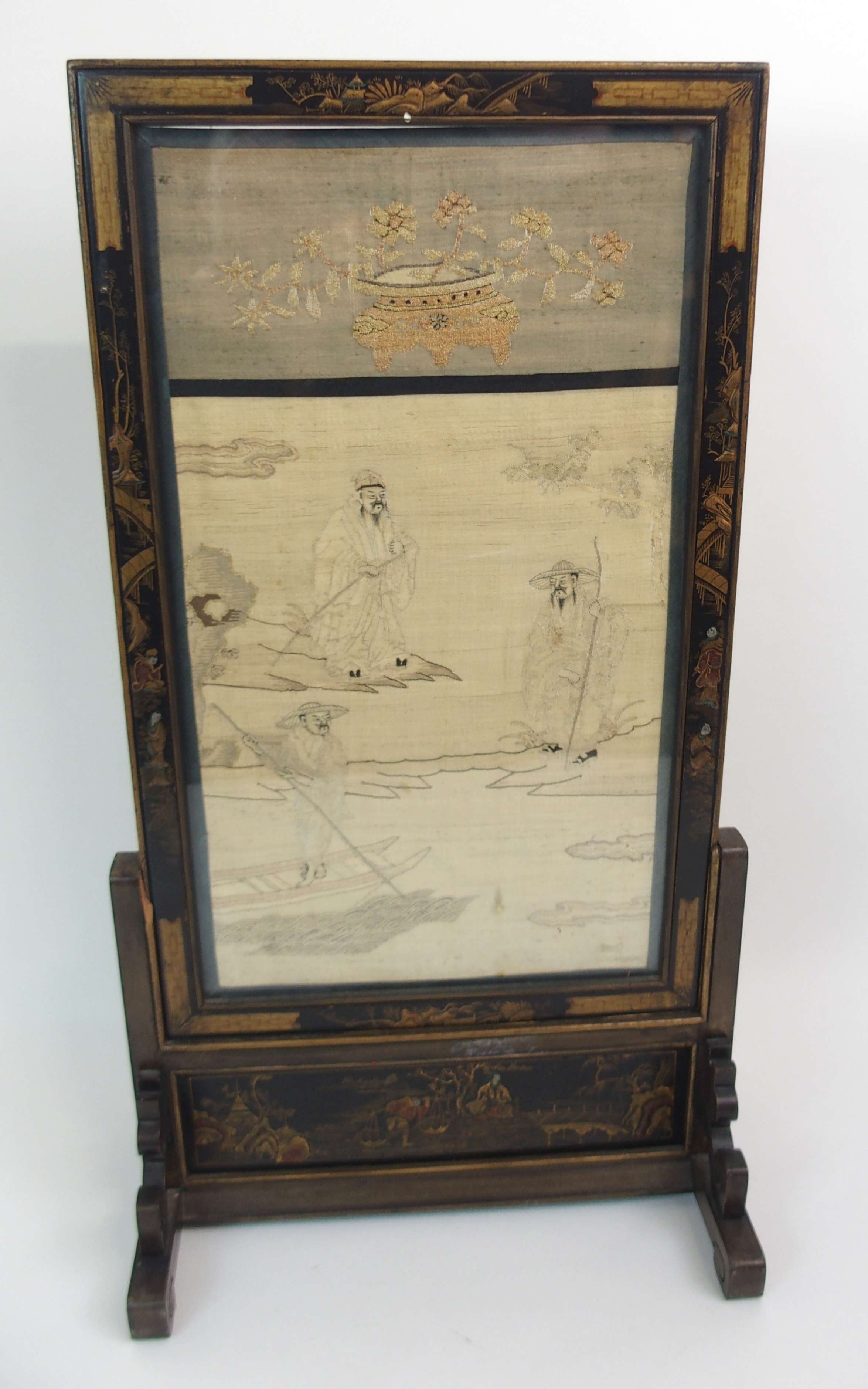 Lot 19 - A CHINESE SILK TABLE SCREEN woven with figures on islands and a sampan beneath a jardiniere of