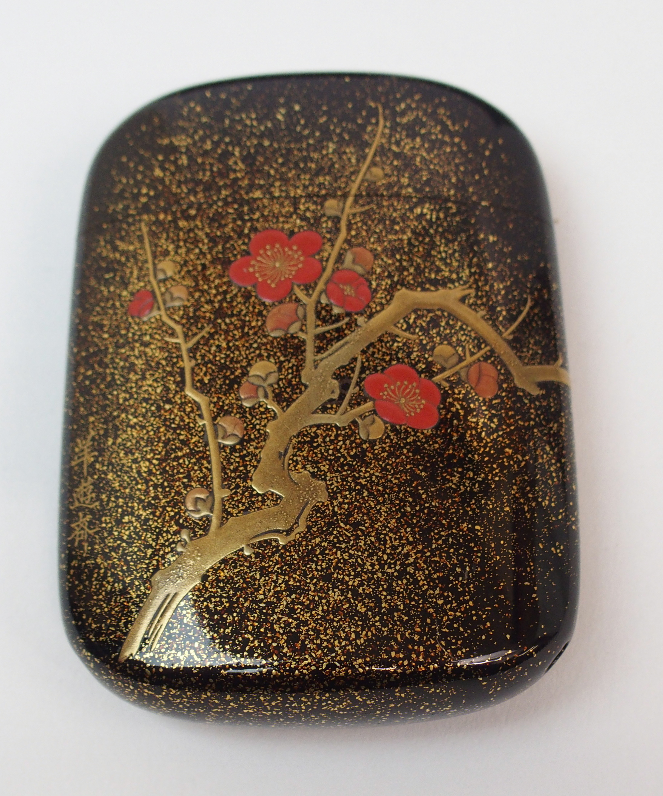 Lot 5 - TWO BLACK AND GOLD LACQUERED TWO-SECTION BOXES decorated with birds amongst foliage (cracks and