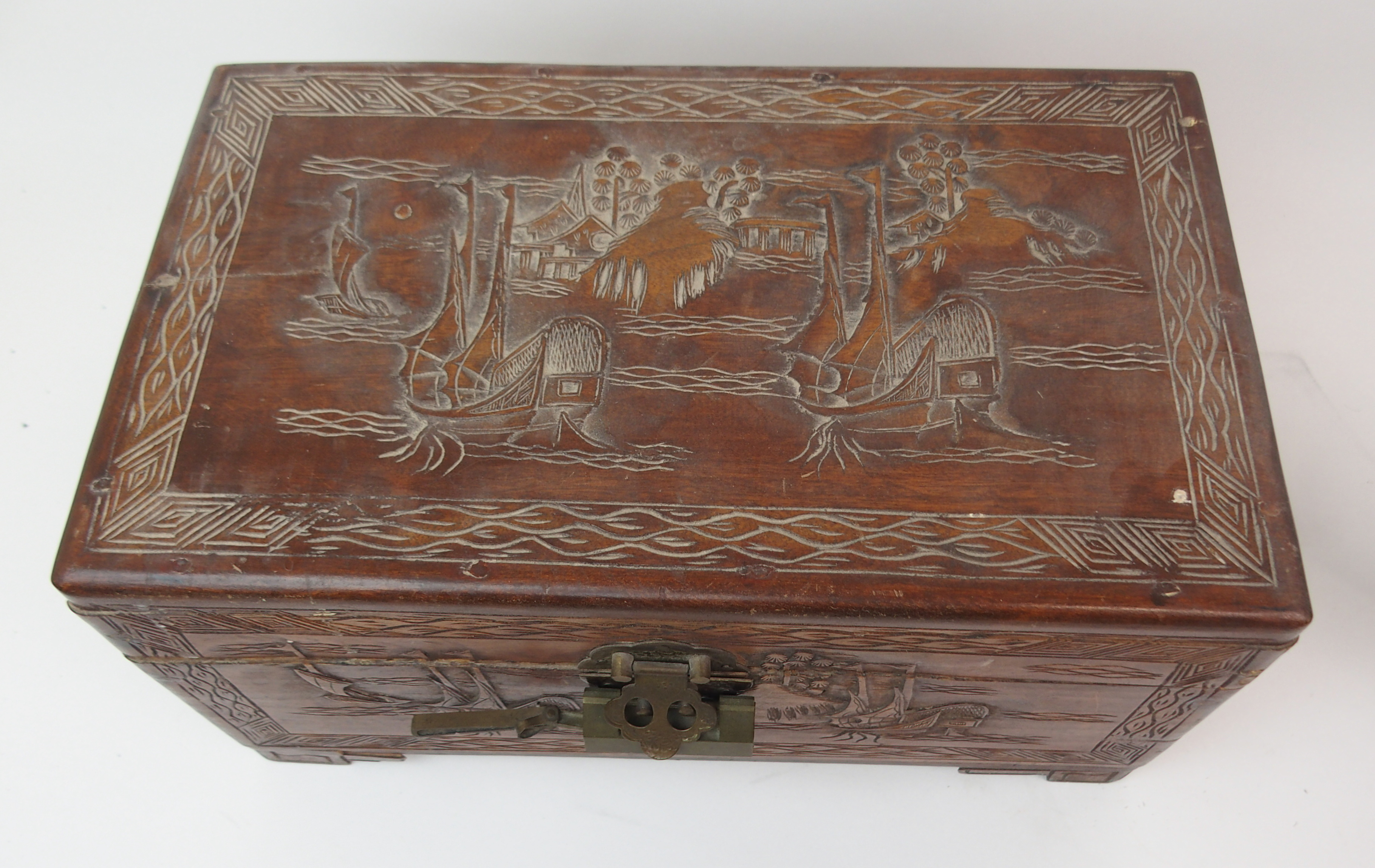 Lot 36 - A CHINESE CARVED BUFFALO HORN SAMPAN with four figures and shelter on board resting on hardwood