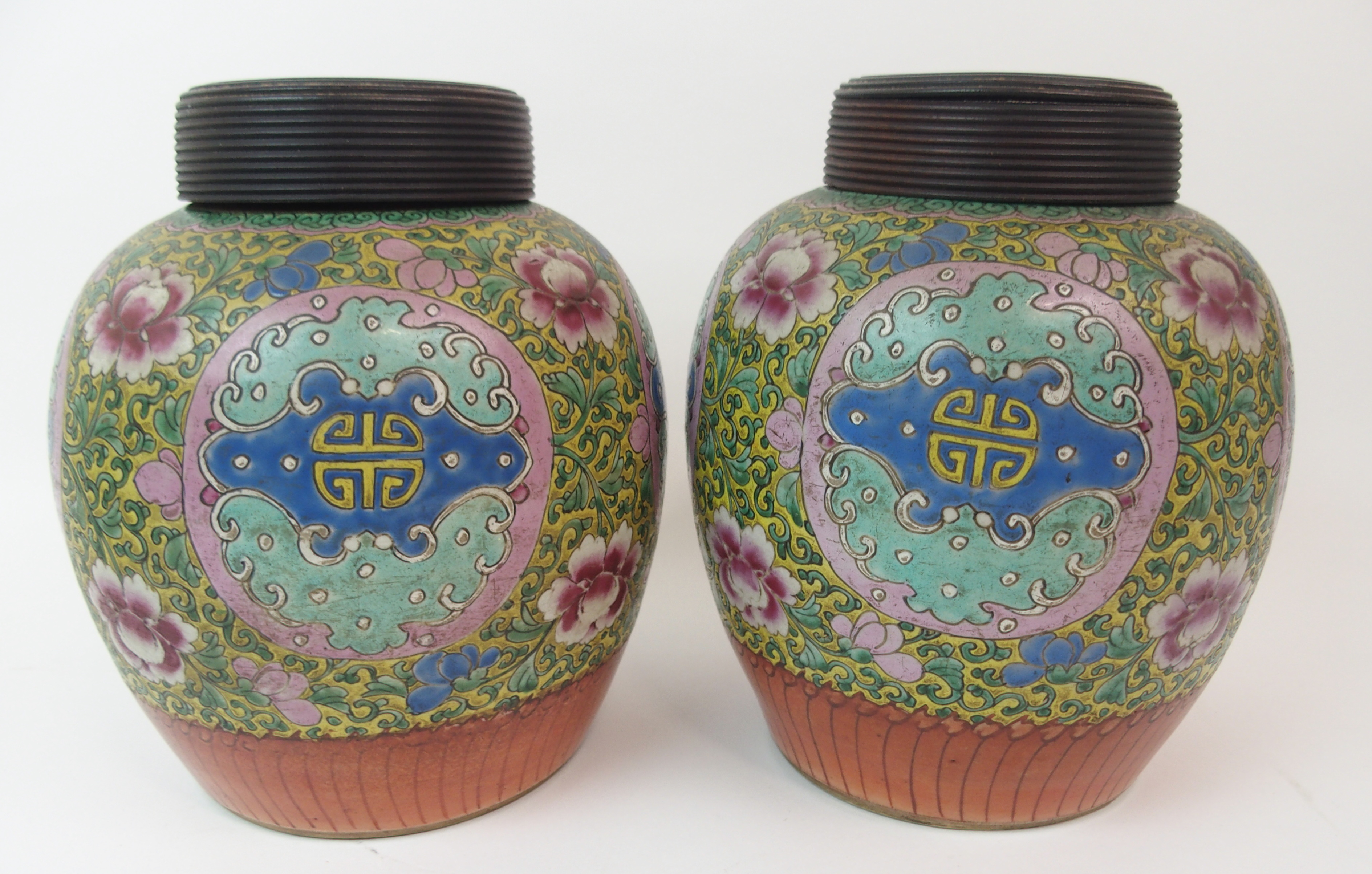Lot 14 - THREE CANTON JARS painted with shou medallions amongst foliage on a yellow ground above a stiff leaf