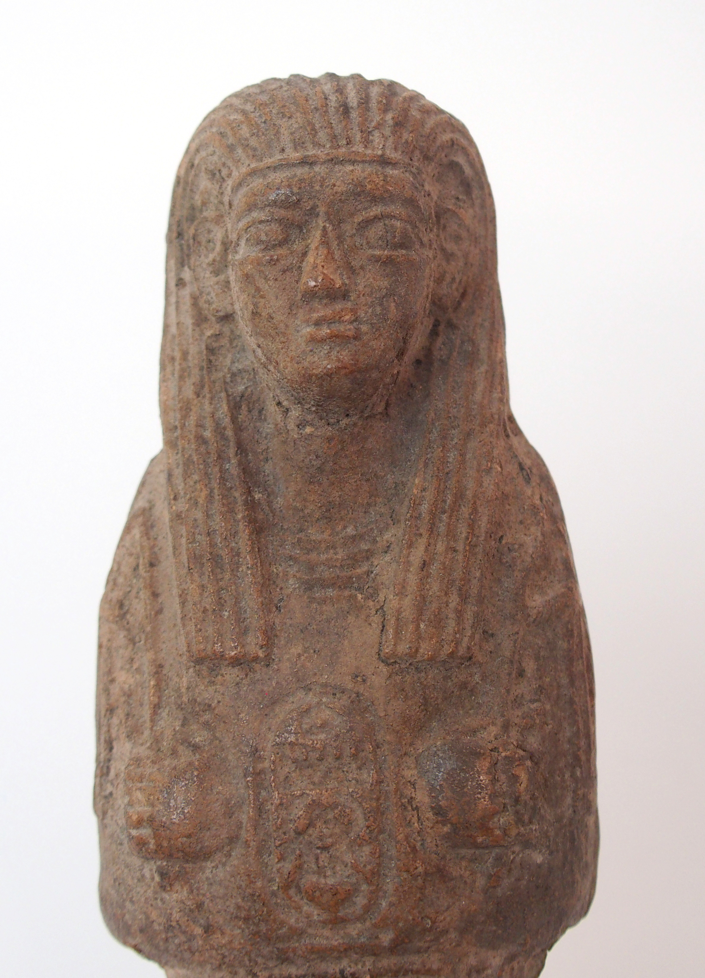 Lot 16 - AN EGYPTIAN SHABTI DOLL moulded with hieroglyphs (repaired), 17cm high and another, 13cm high (2)
