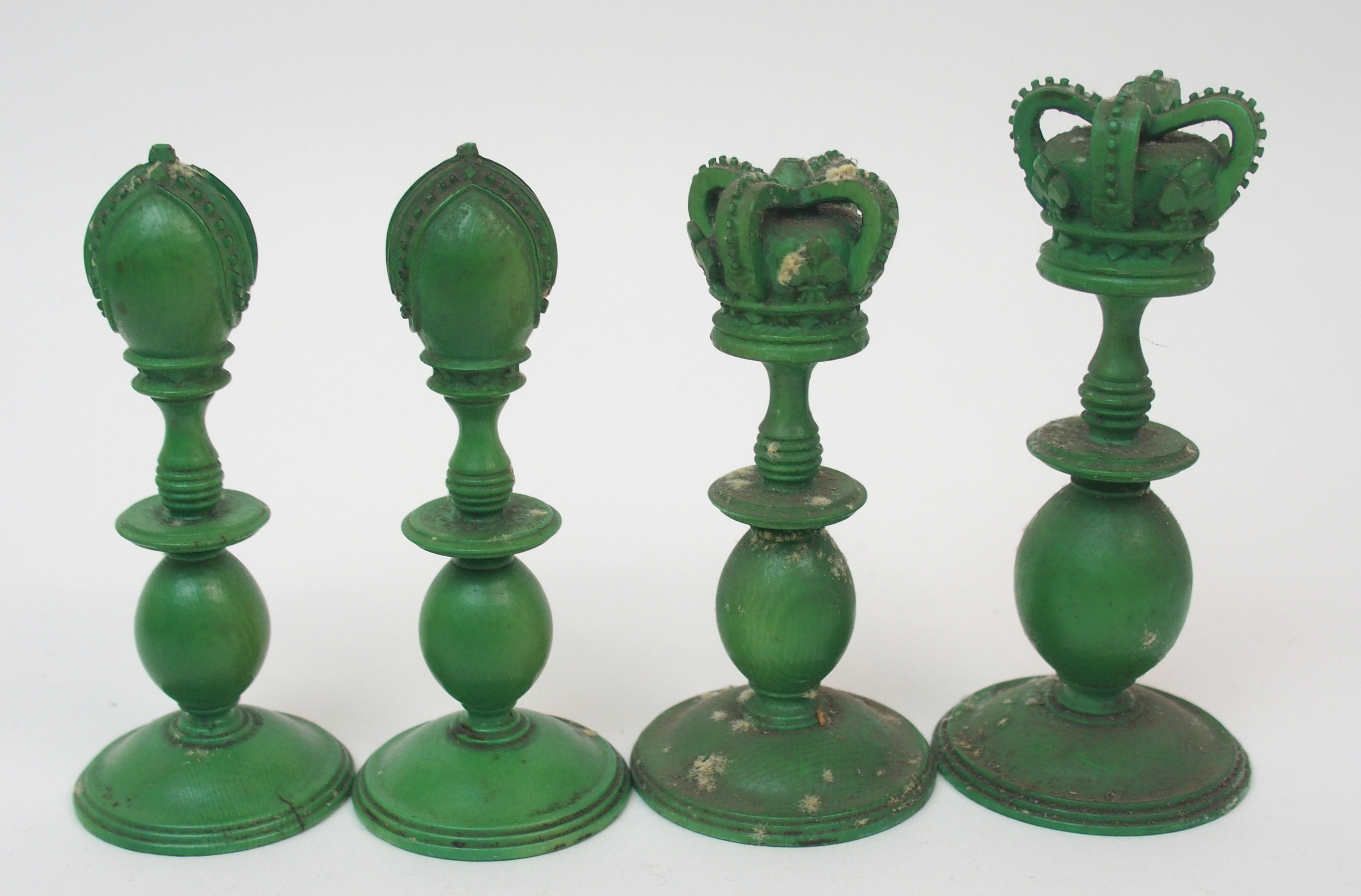 Lot 41 - AN EAST INDIAN IVORY CHEST SET probably Berhampore, one set stained green, lacking one pawn, (with