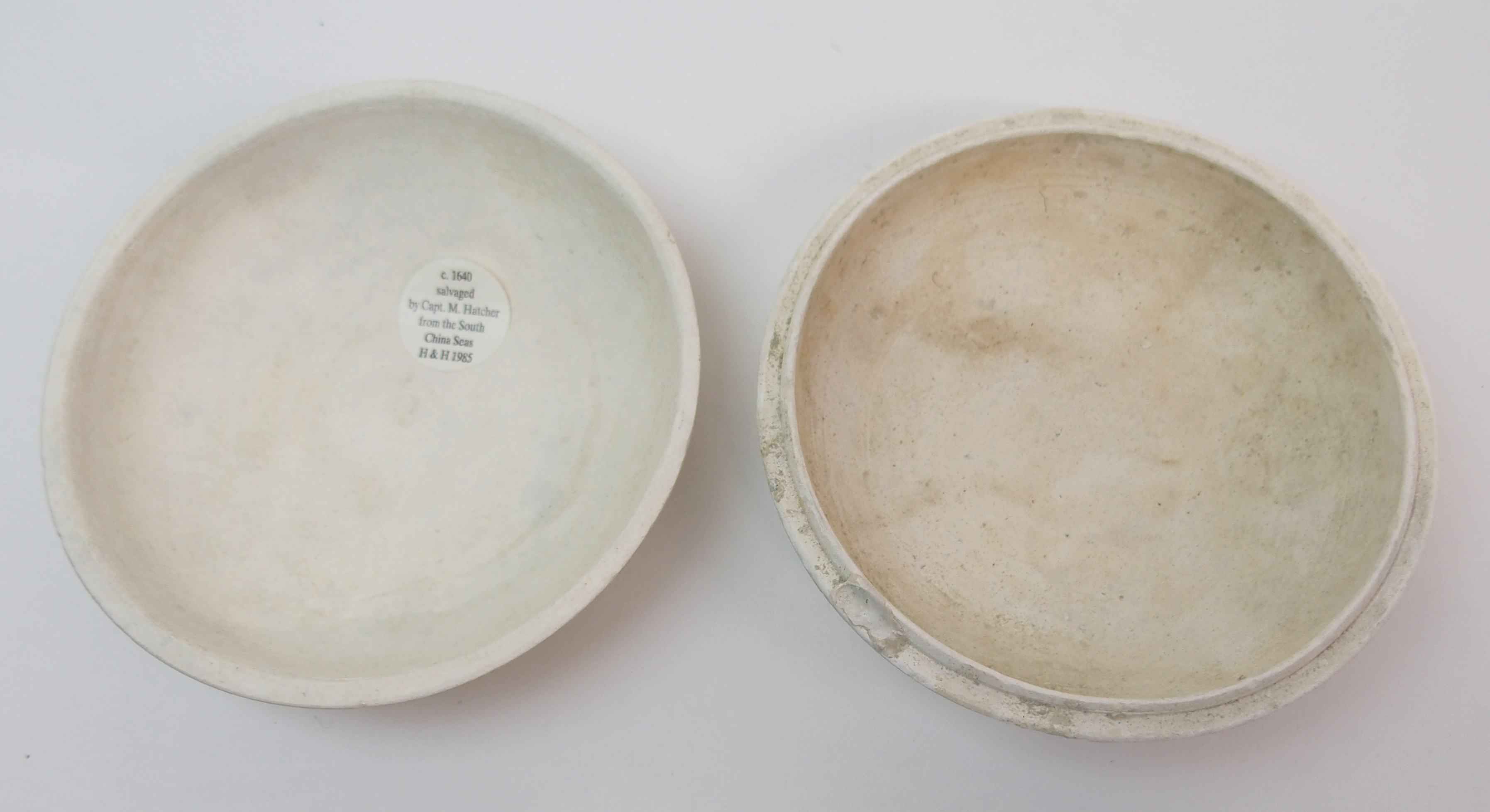 Lot 12 - A PAIR OF CHINESE BISCUIT BOWLS AND COVERS moulded with foliage ensuing from rockwork above fluted