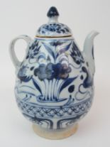Lot 48 - A CHINESE MING STYLE BLUE AND WHITE WINE POT painted with ducks and aquatic foliage (cover damaged