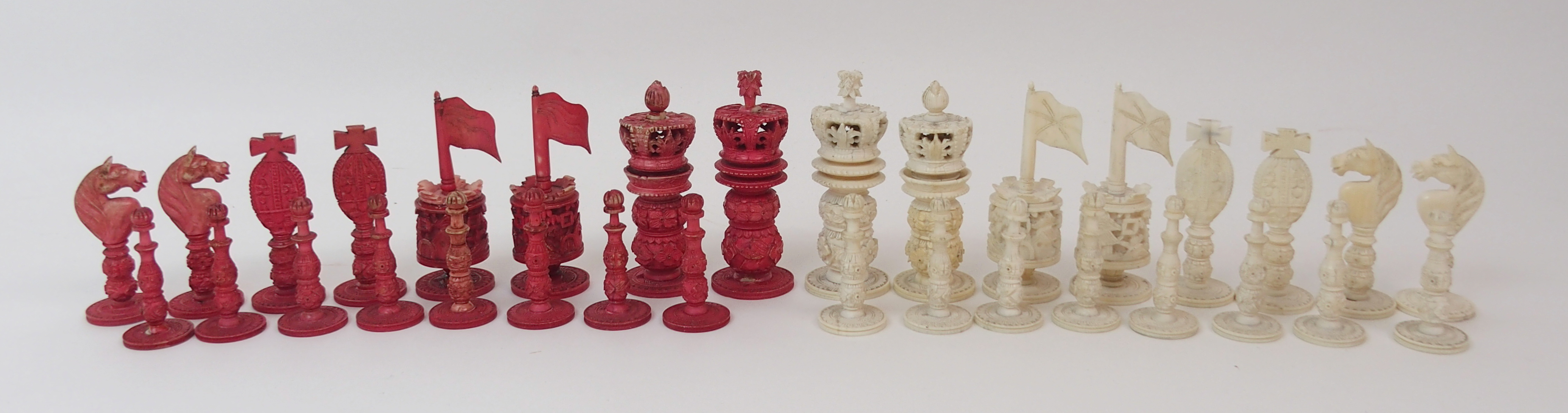 Lot 9 - A CHINESE EXPORT IVORY CHESS SET of typical form, one red stained set, pawns, 5cm high, Kings, 8cm