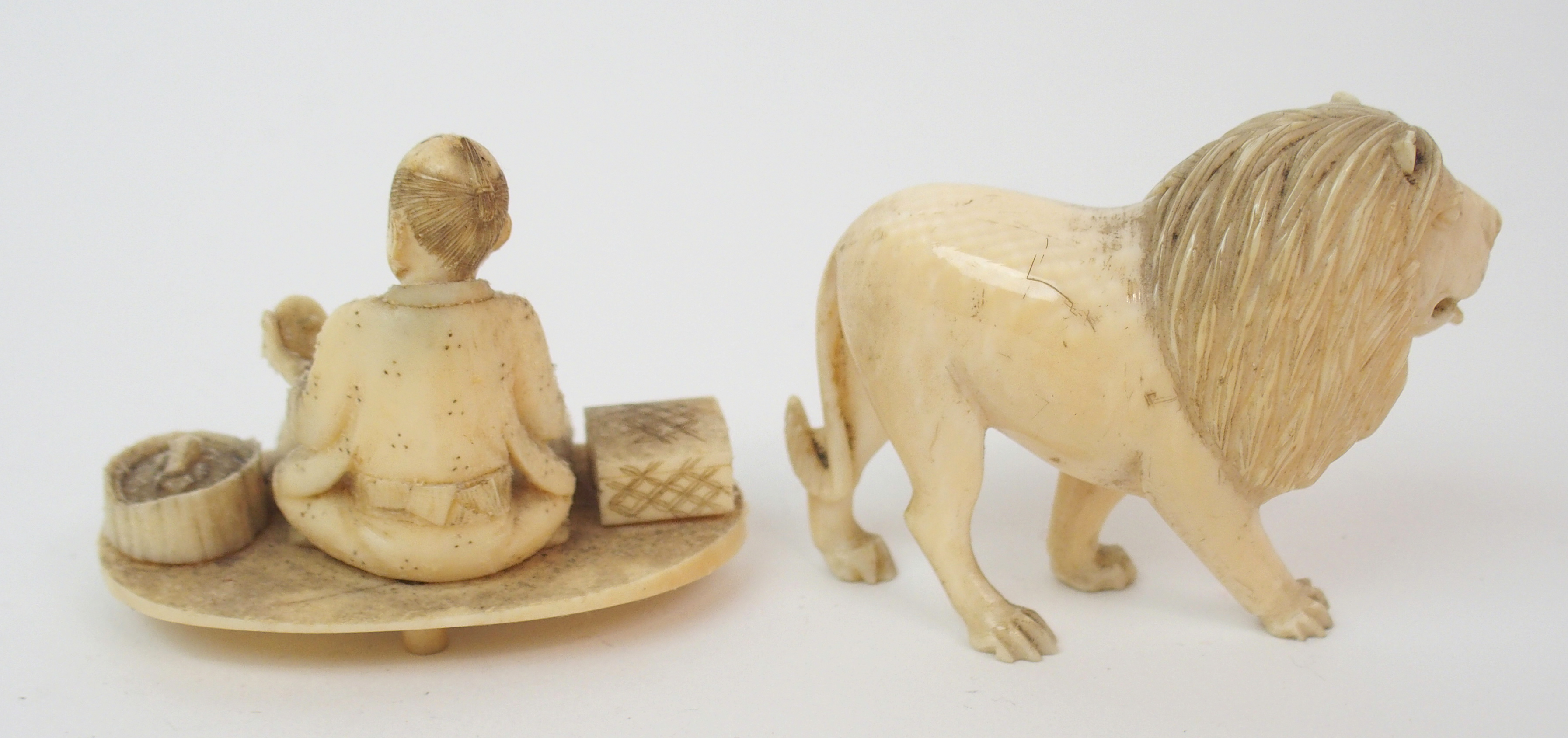 Lot 42 - A SET OF THIRTY CARVED DRAUGHTS 3cm diameter, two Chinese dice tumblers, 6.5cm high, lion 5m high,
