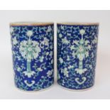 Lot 34 - A PAIR OF CANTON BRUSH WASHER VASES painted with bats, peonies and brocade on a blue ground, gilt