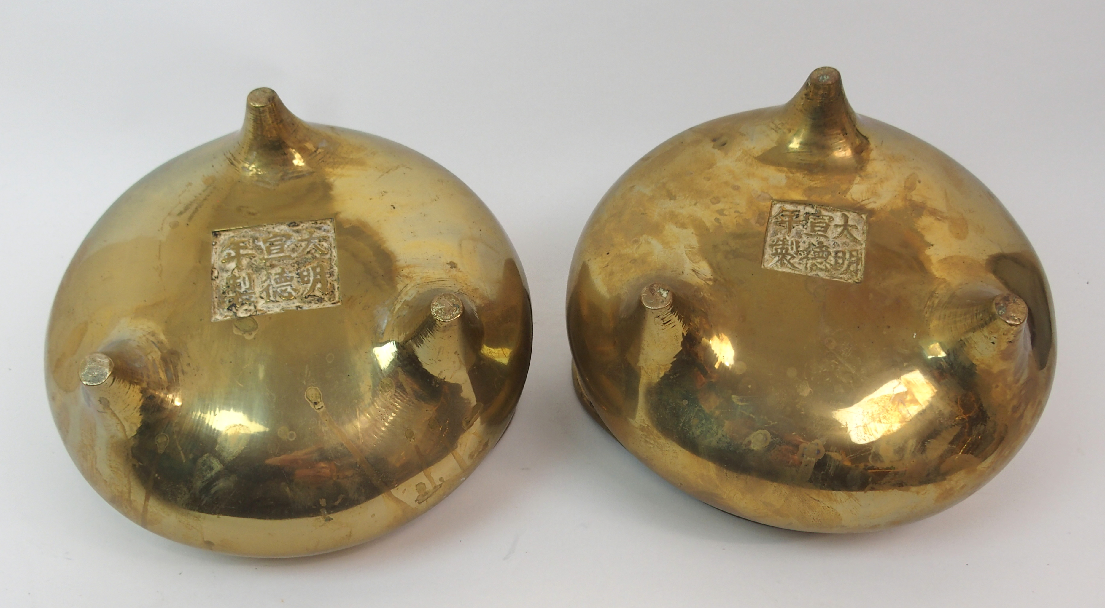 Lot 58 - A CHINESE BRASS TWO-HANDLED CENSER on tripod base, cast six character mark, 15cm high x 23cm