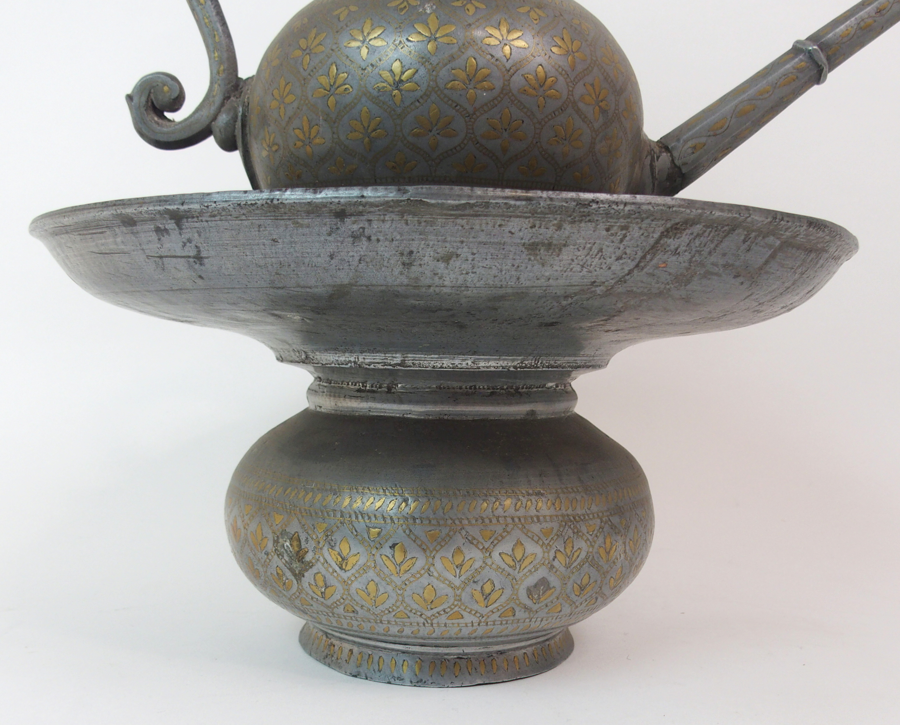 Lot 55 - A BIDRI STEEL INLAID EWER AND BASIN each decorated with gilt foliate bands within stylised