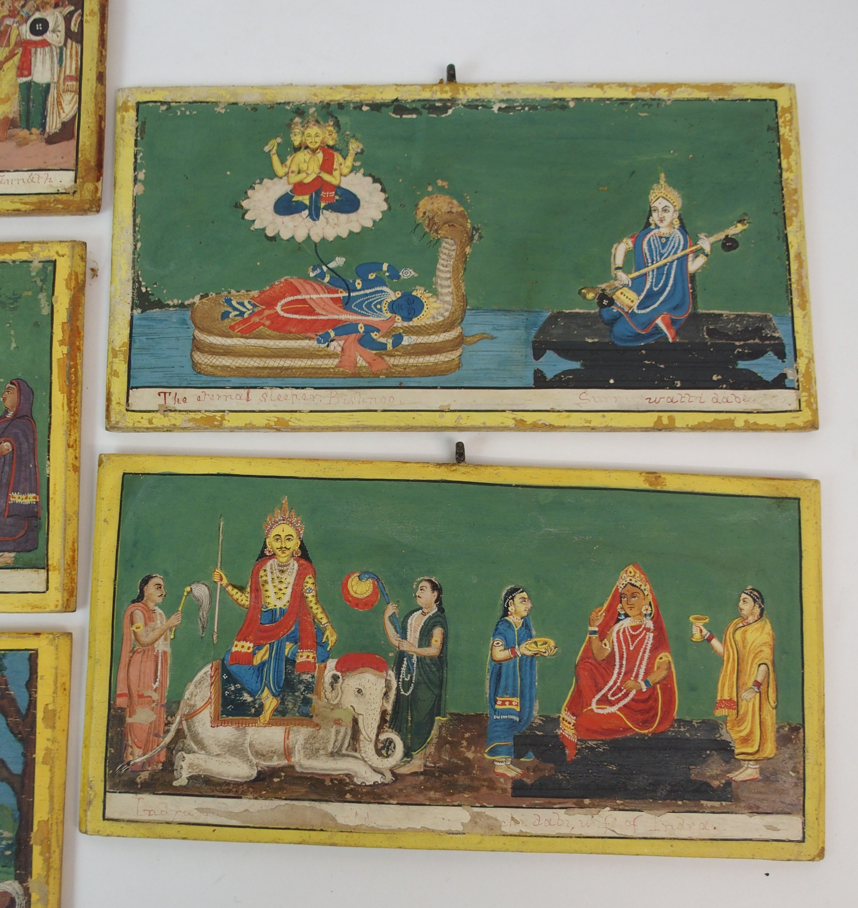 Lot 56 - SEVEN INDIAN POLYCHROME DOUBLE-SIDED WOOD PANELS depicting Jagannath daru and ancient carpenter, the