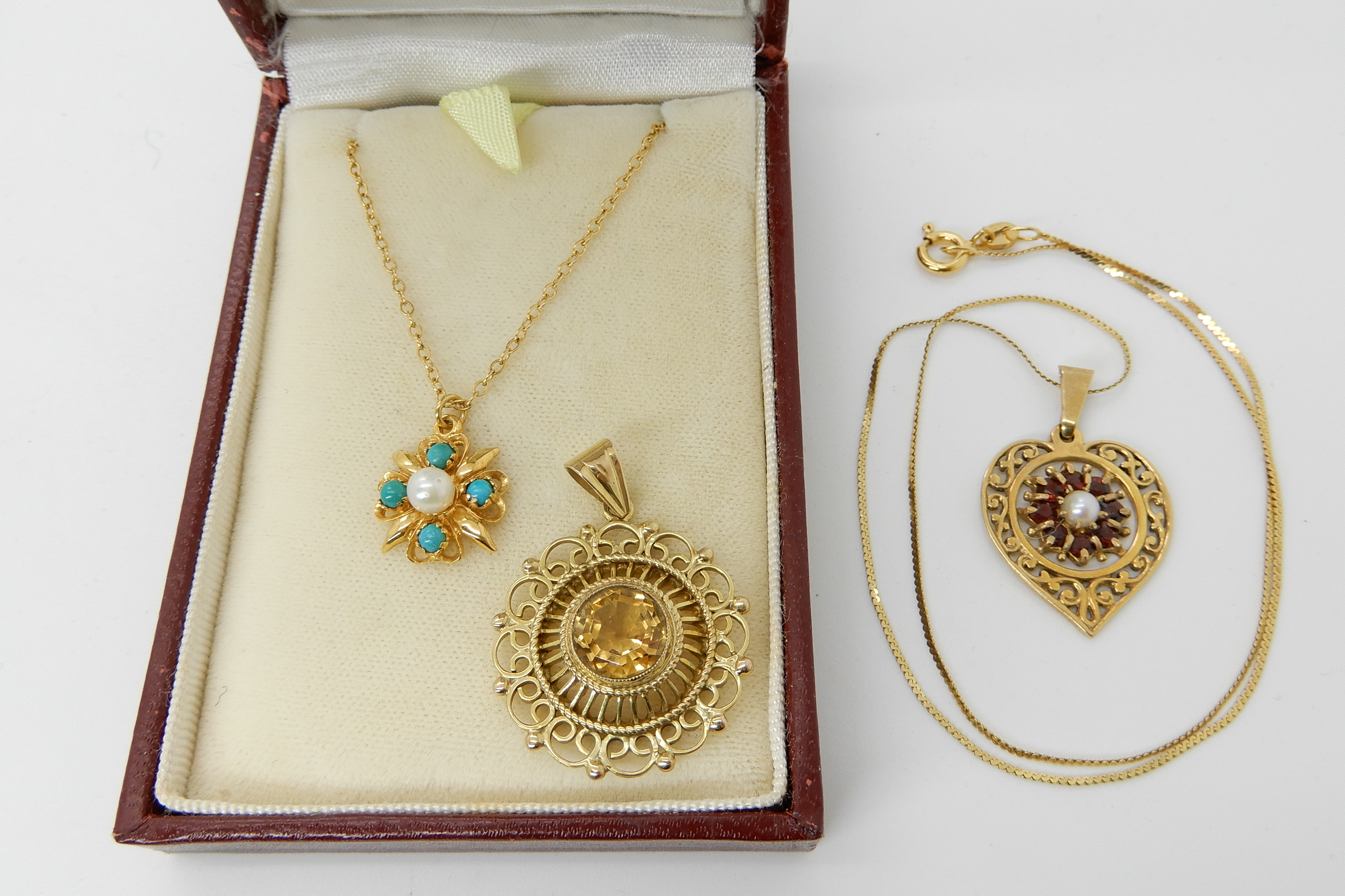Lot 10 - A 9ct turquoise and pearl pendant and chain length 46cm, a 9ct gold garnet and pearl heart shaped