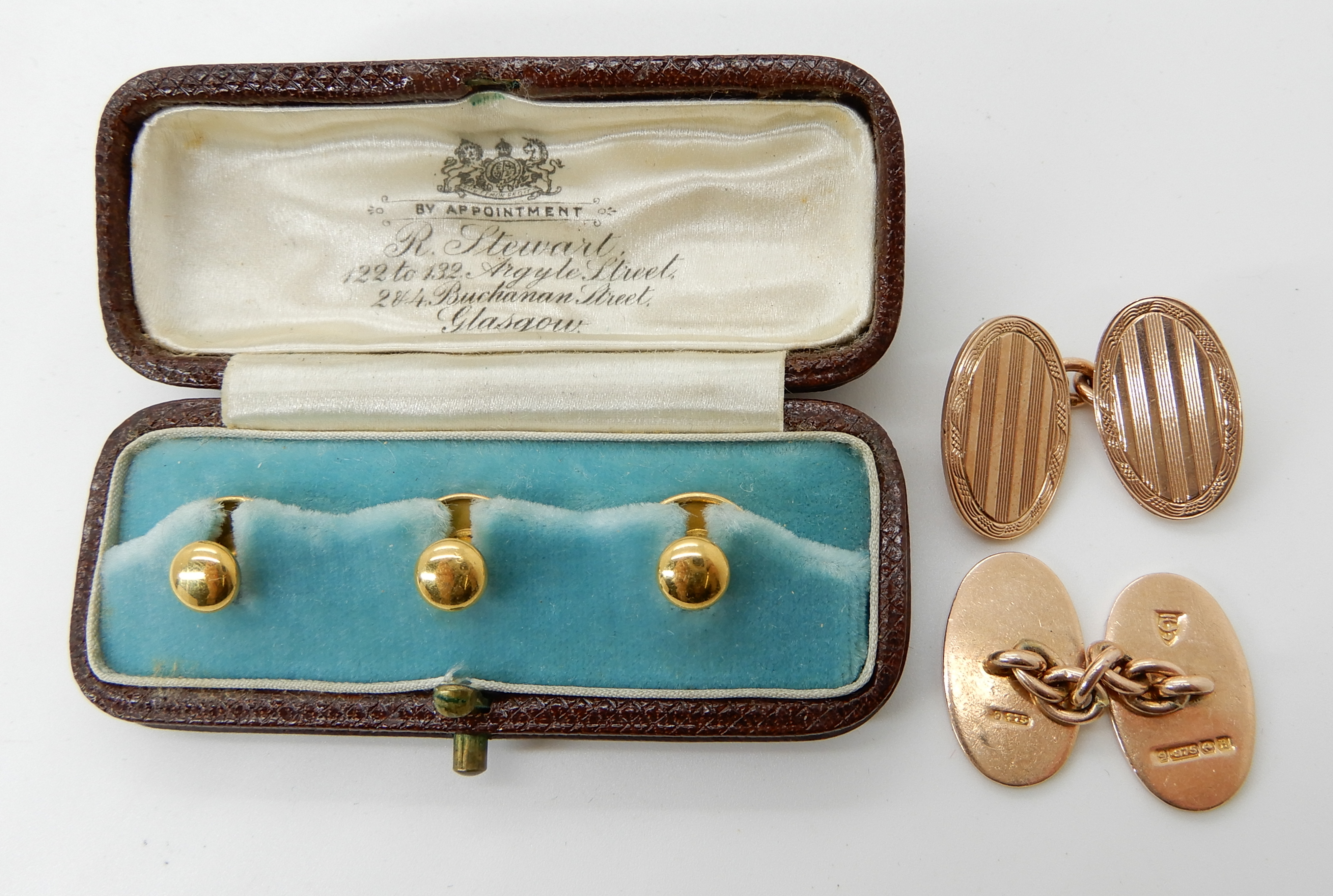 Lot 29 - A pair of 9ct gold G.H Johnson cufflinks weight 11.6gms and a boxed set of three 18ct gold studs 2.