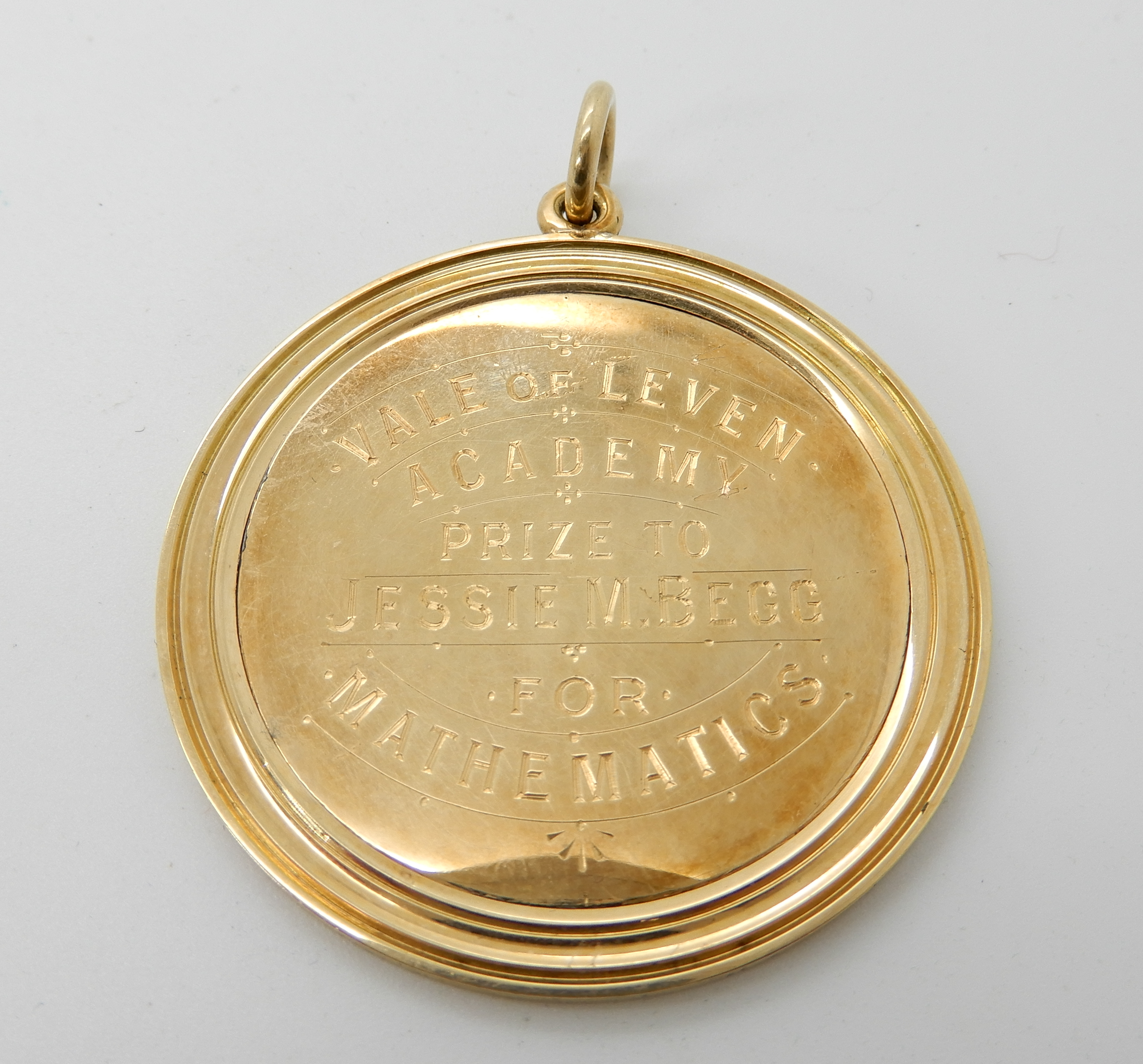 Lot 54 - A 15ct gold Vale of Leven Mathematics prize medallion 1905, diameter 4.3cms, weight 13.6gms