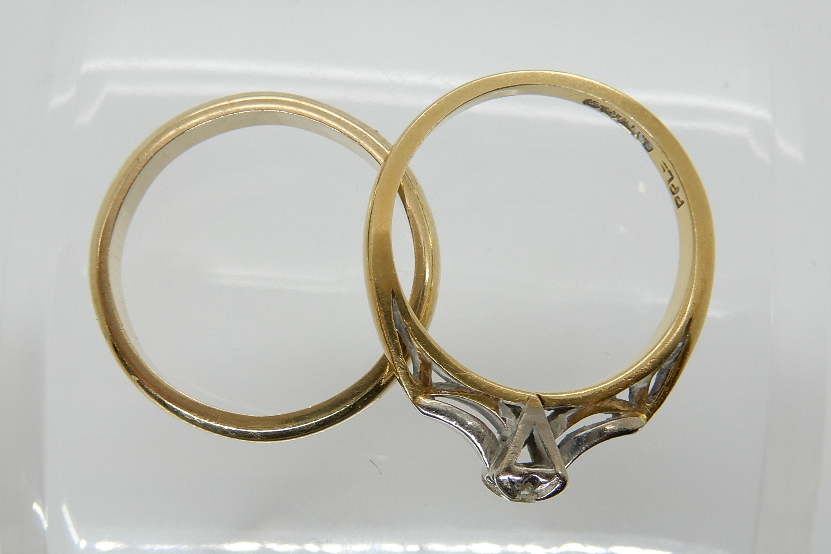 Lot 44 - An 18ct gold diamond illusion set ring, size L1/2, weight 2.9gms, together with a 9ct gold wedding