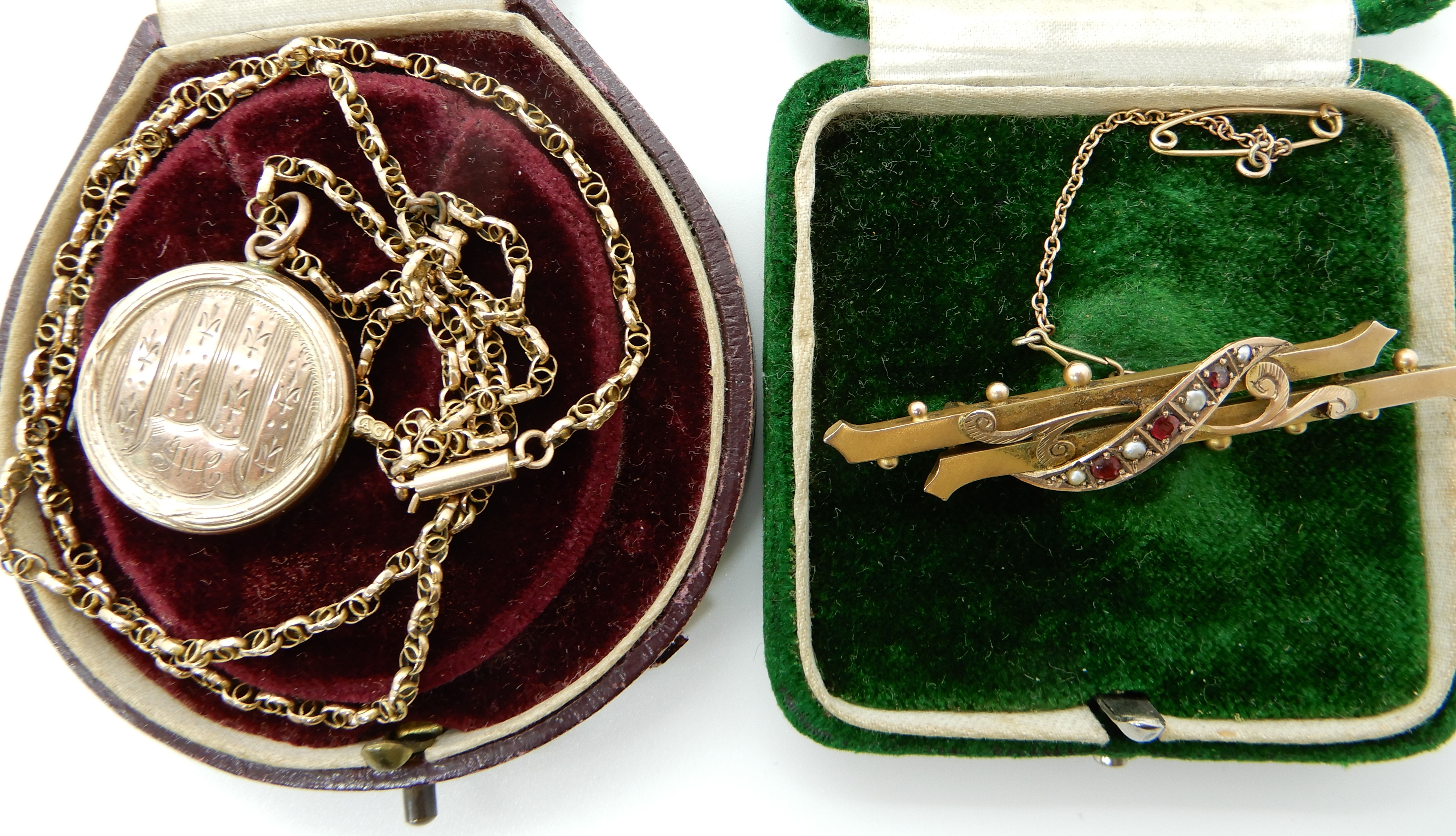 Lot 46 - A 9ct gold red gem and pearl brooch together with a yellow metal (B&F) locket with 9ct vintage fancy