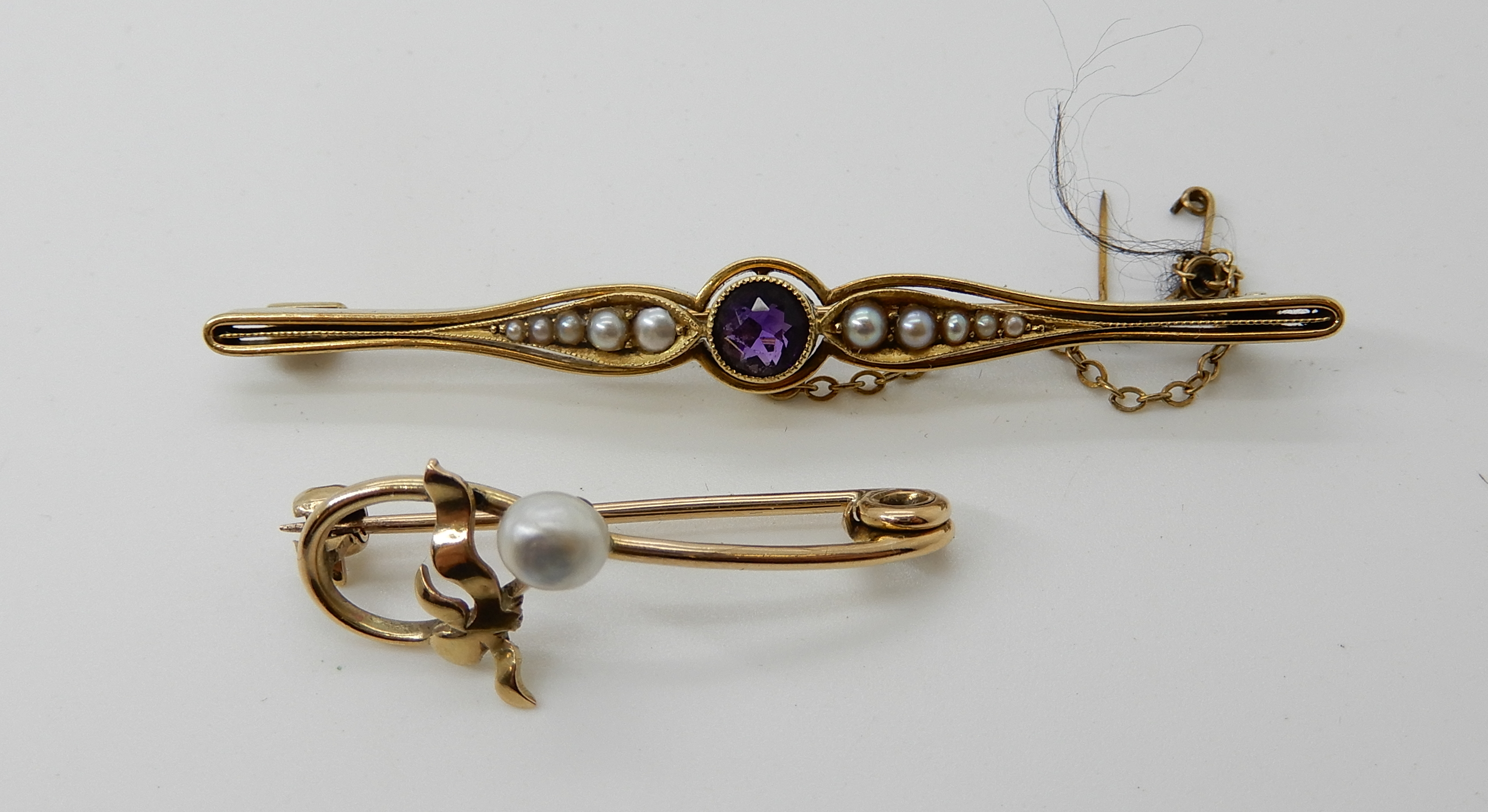 Lot 55 - A 15ct gold amethyst and pearl brooch length 6.3cm, weight 6gms, together with a yellow metal
