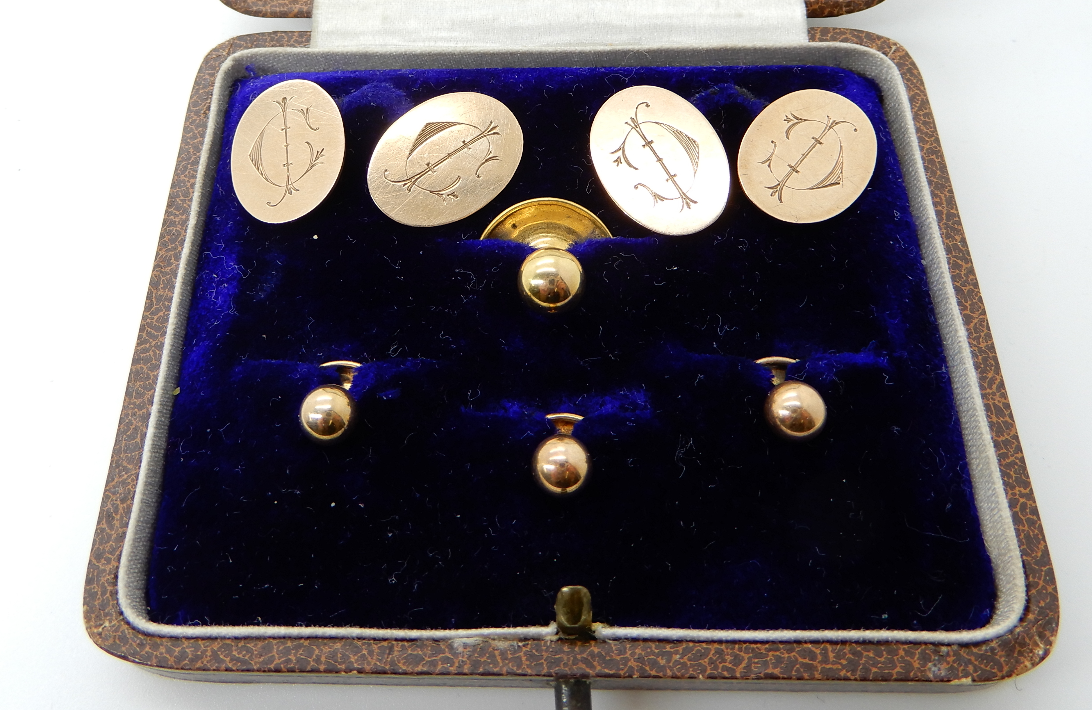 Lot 56 - A pair of 9ct rose gold cufflinks, together with four 9ct gold shirt studs weight together 8.7gms