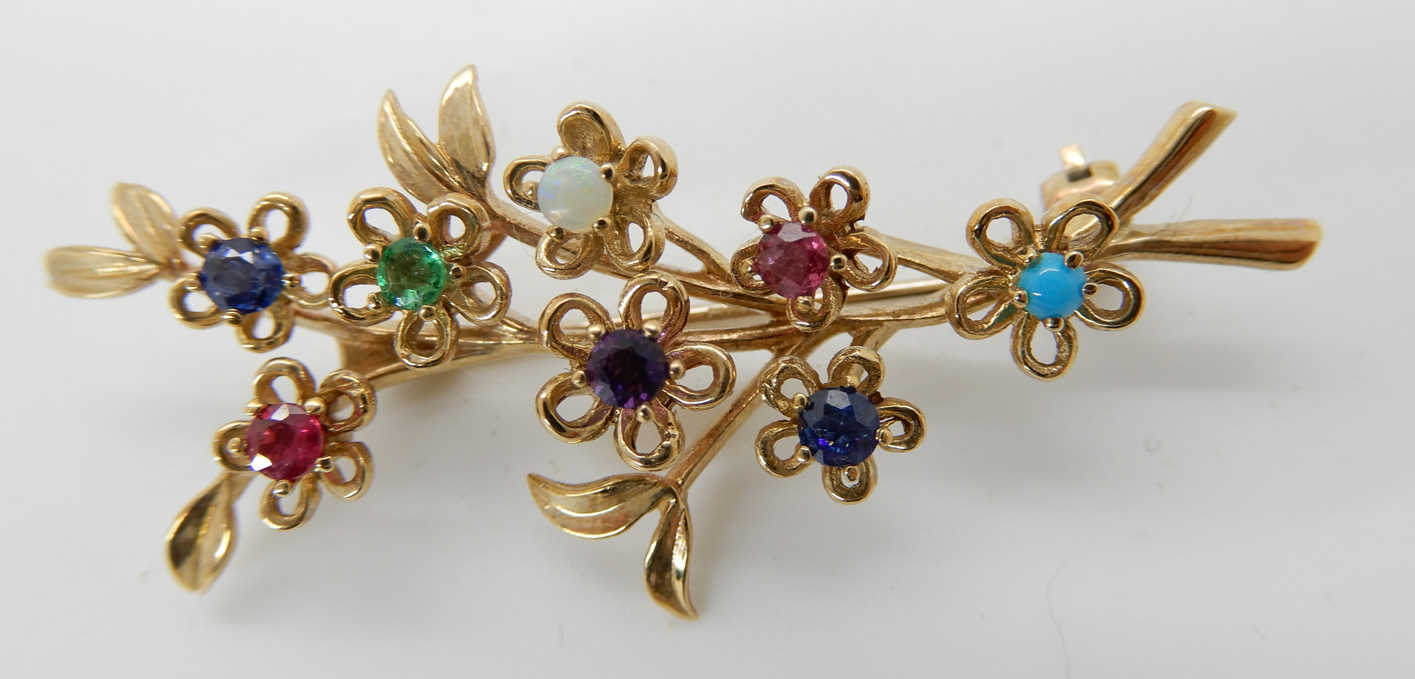 Lot 37 - A 9ct gold mixed gem set bunch of flower brooch, length 4.7cm, together with a 9ct gold pearl set