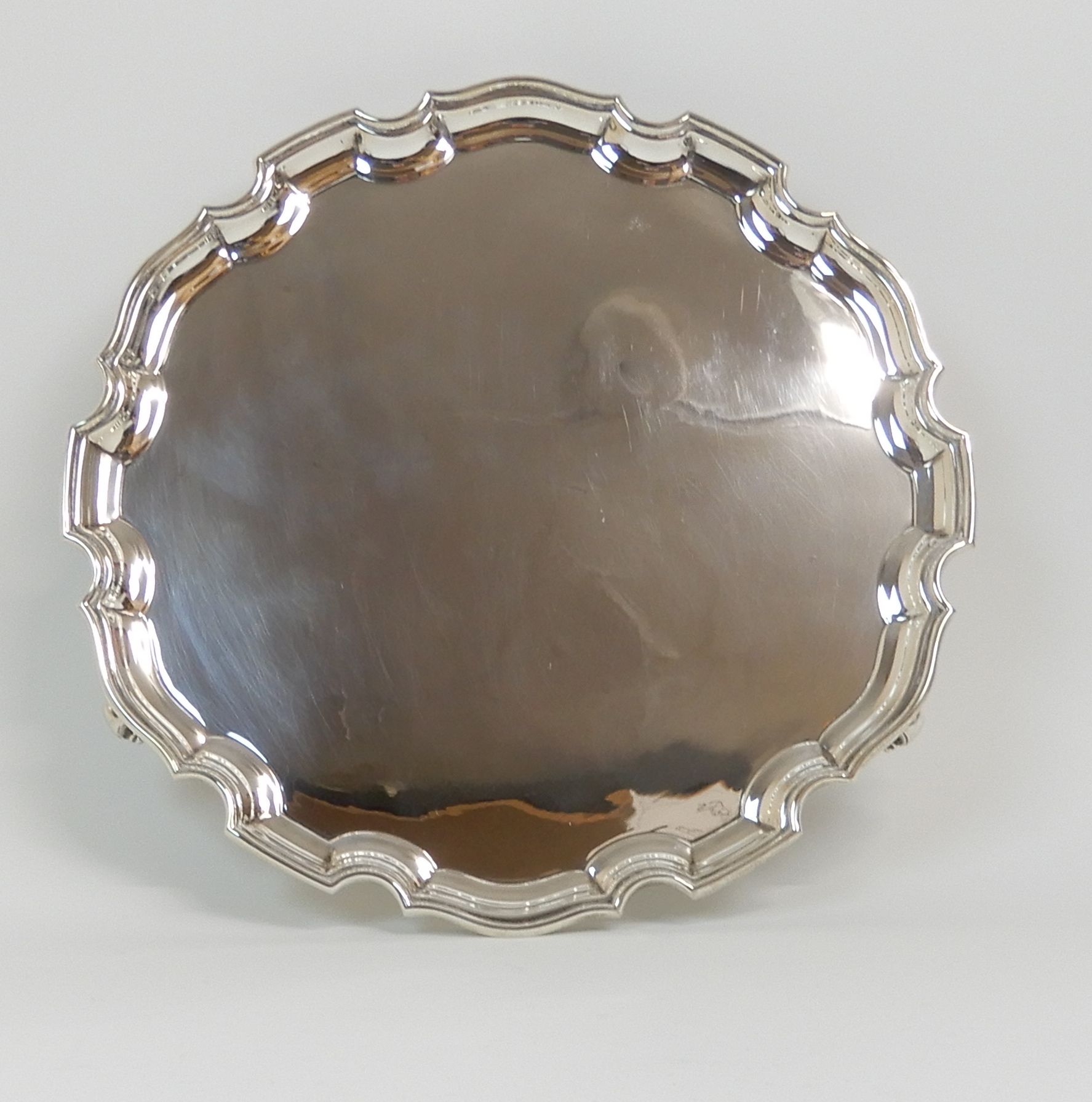 Lot 124 - A SILVER SALVER by Stower & Wragg Limited, Sheffield 1941, of circular form with raised scalloped