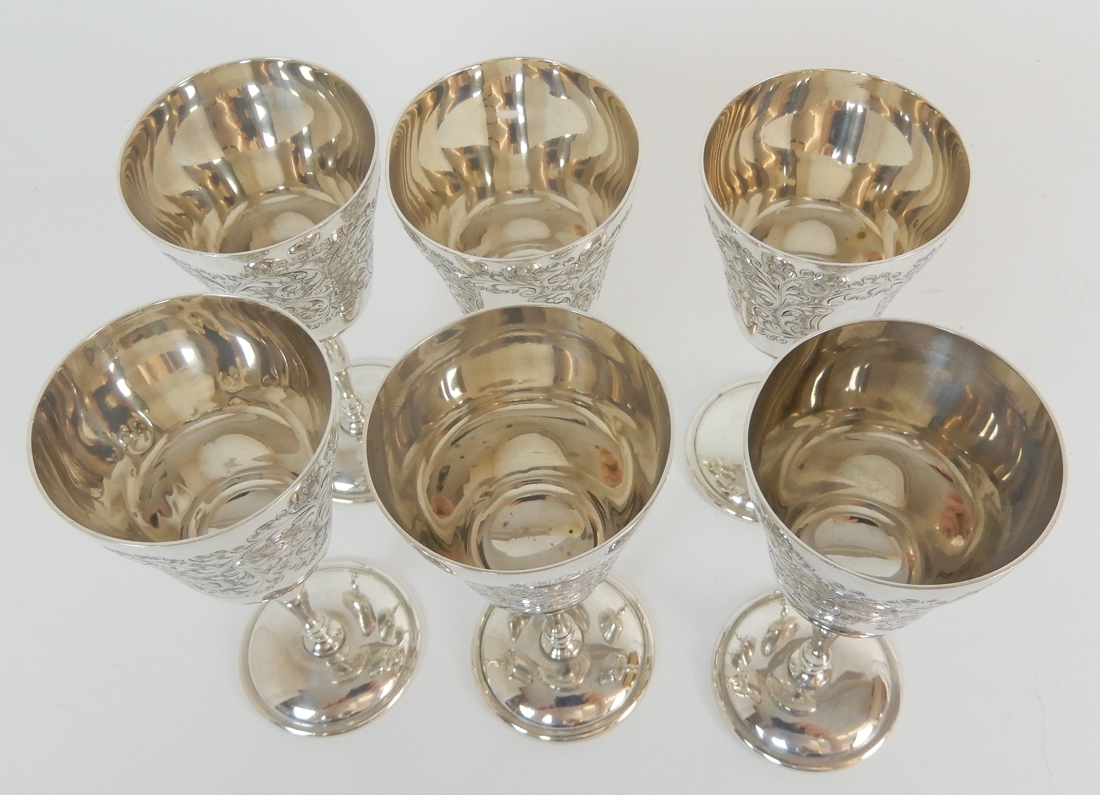 Lot 153 - A SET OF SIX SILVER WINE GOBLETS by Charles S Green & Company Limited, Birmingham 1969, with foliate