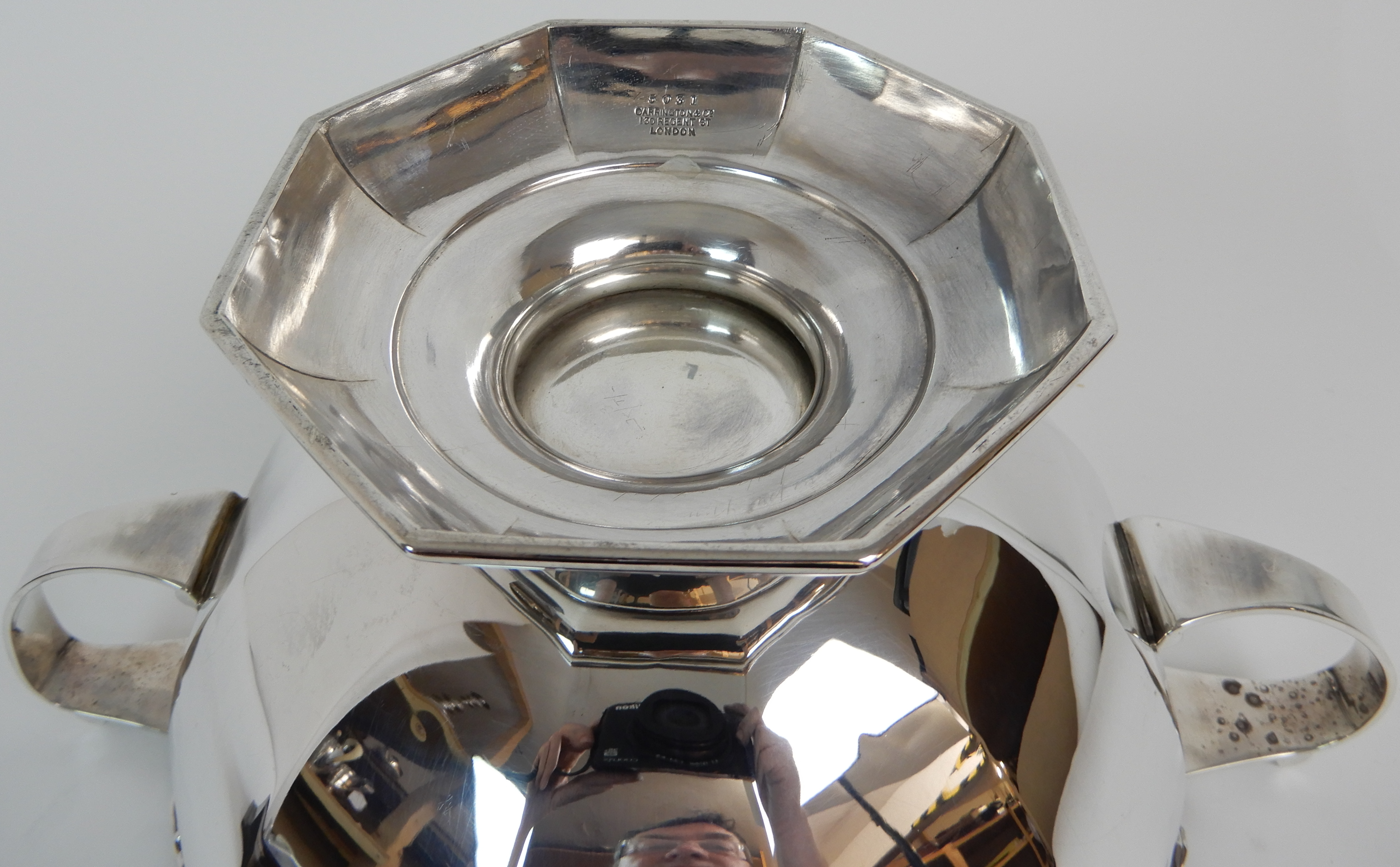 Lot 161 - A SILVER TROPHY PUNCH BOWL by Carrington & Company, London 1911, of dodecagon form with six