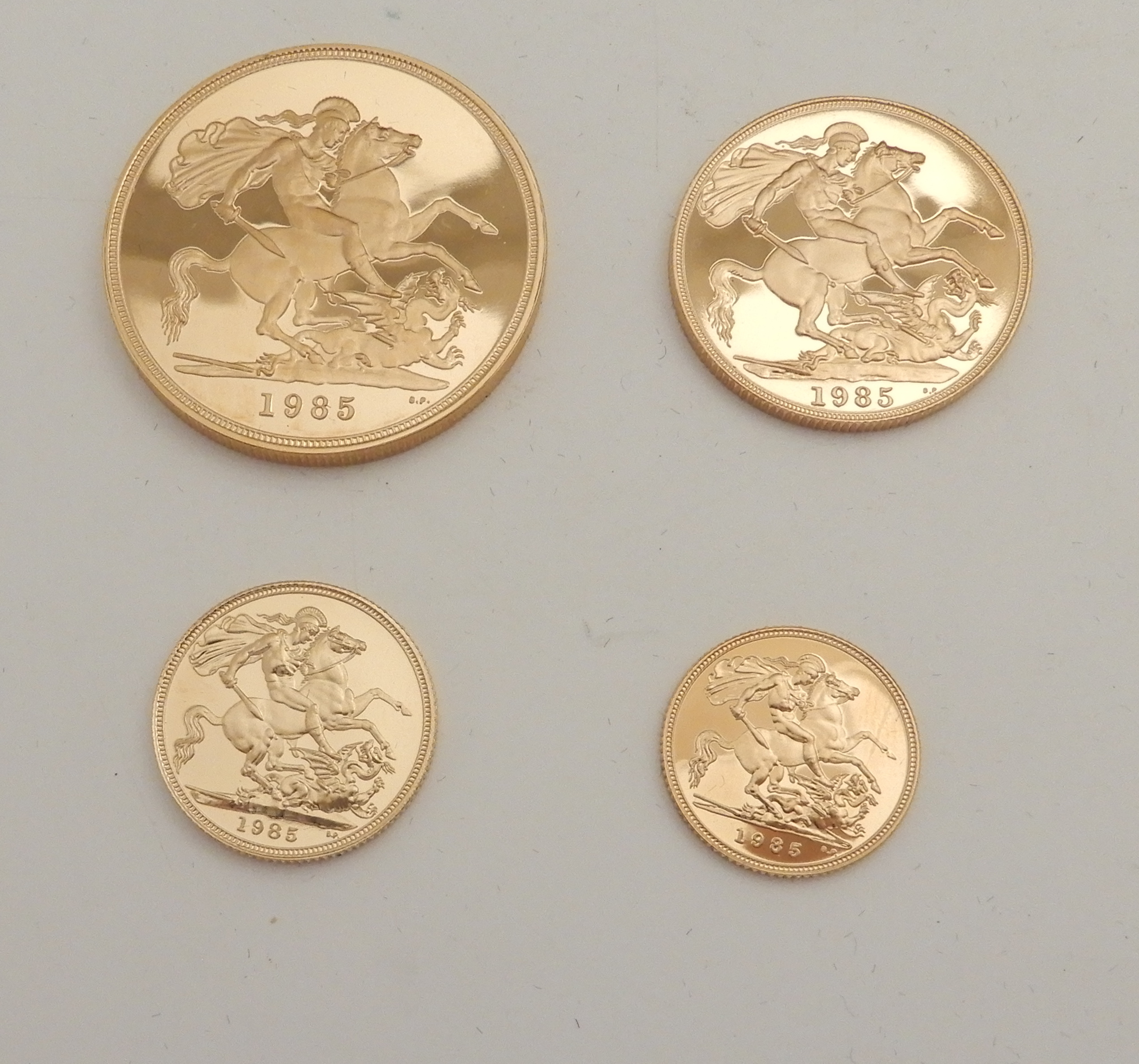 Lot 196 - A 1985 UNITED KINGDOM GOLD FOUR-COIN PROOF SET £5, £2, full sovereign and half sovereign (with