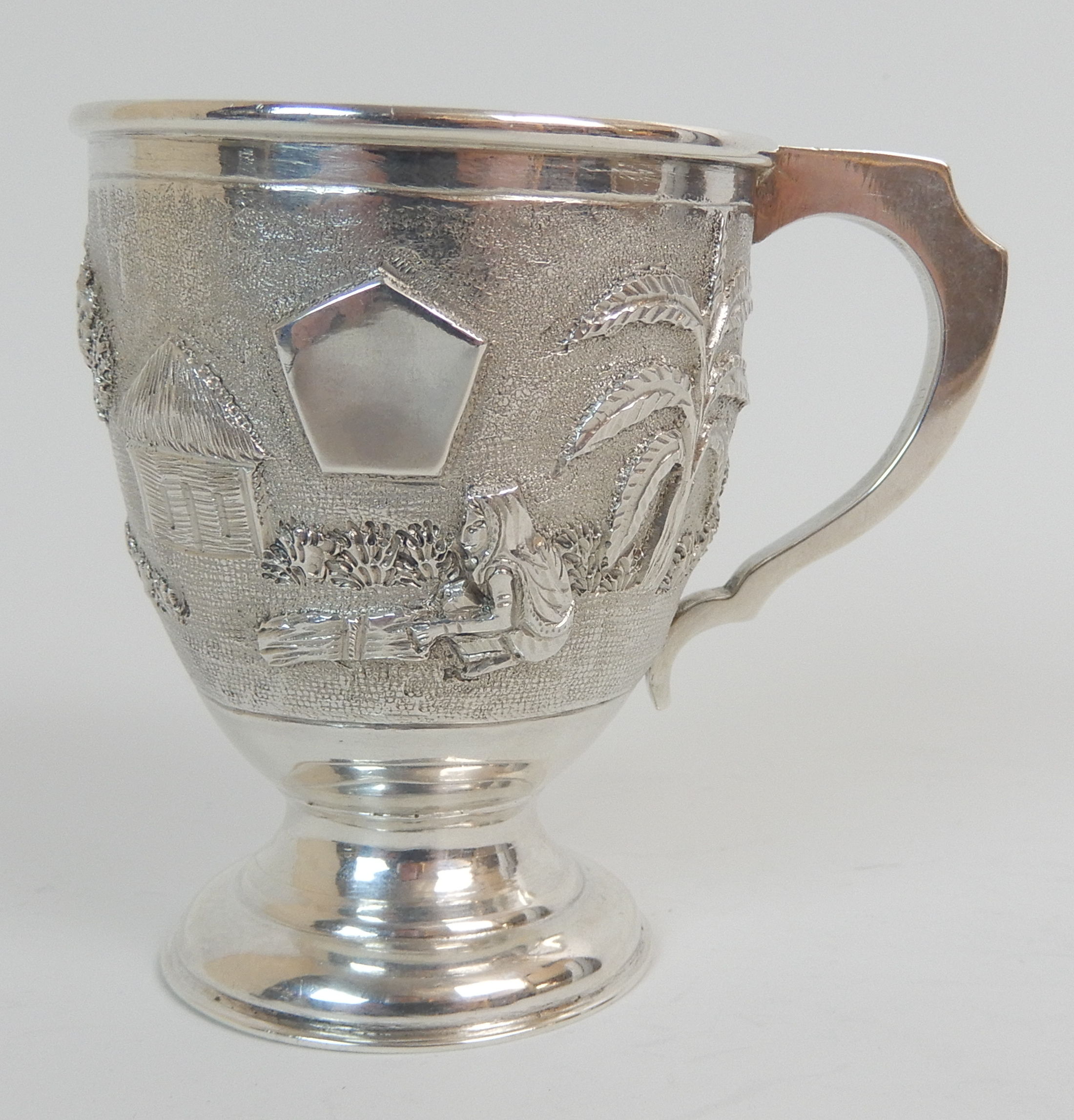Lot 136 - A BURMESE EXPORT SILVER CHRISTENING MUG marked sterling silver, of tapering cylindrical form with