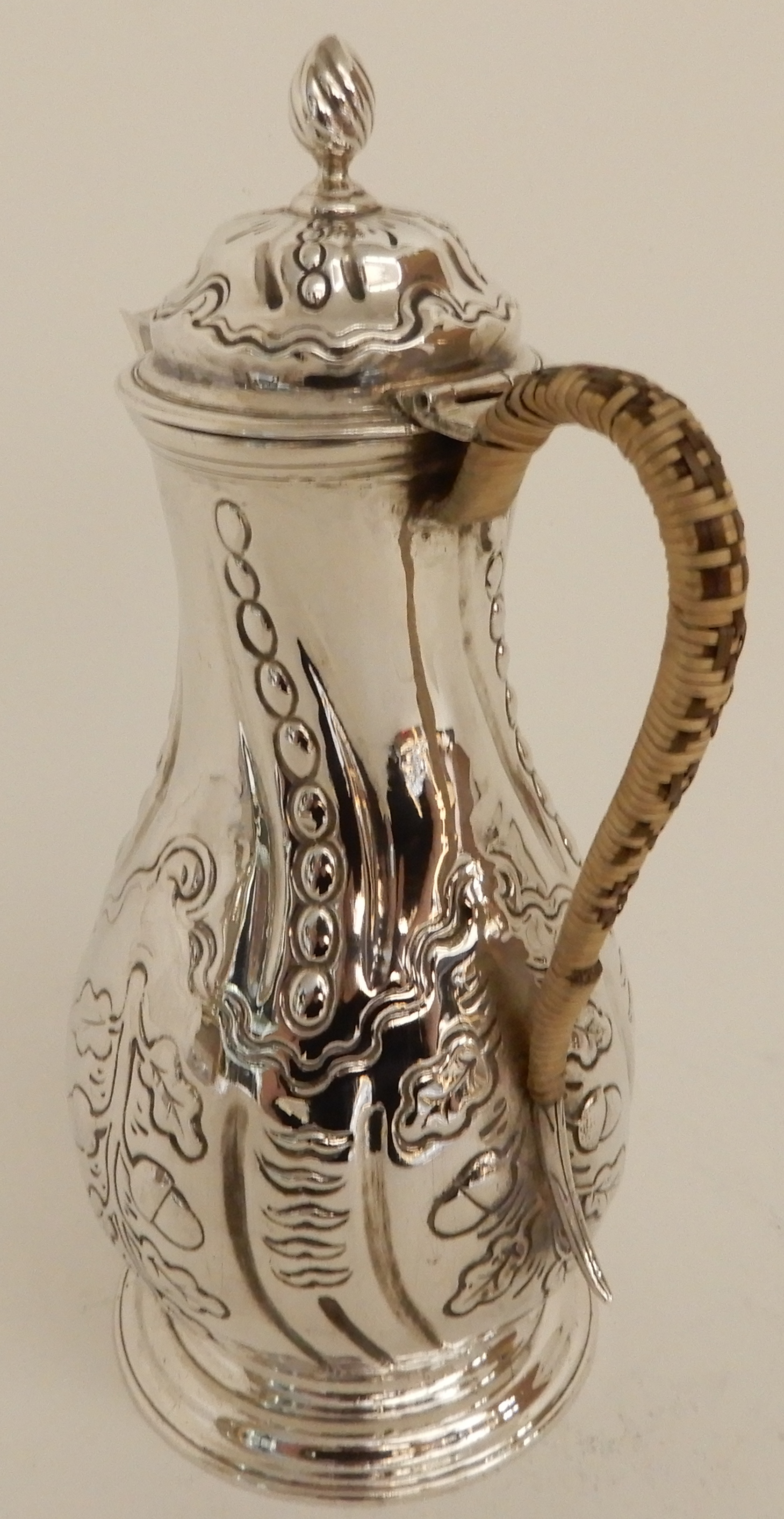 Lot 165 - AN EARLY GEORGE III SILVER CHOCOLATE POT by Thomas Whipham and Charles Wright, London 1763, of