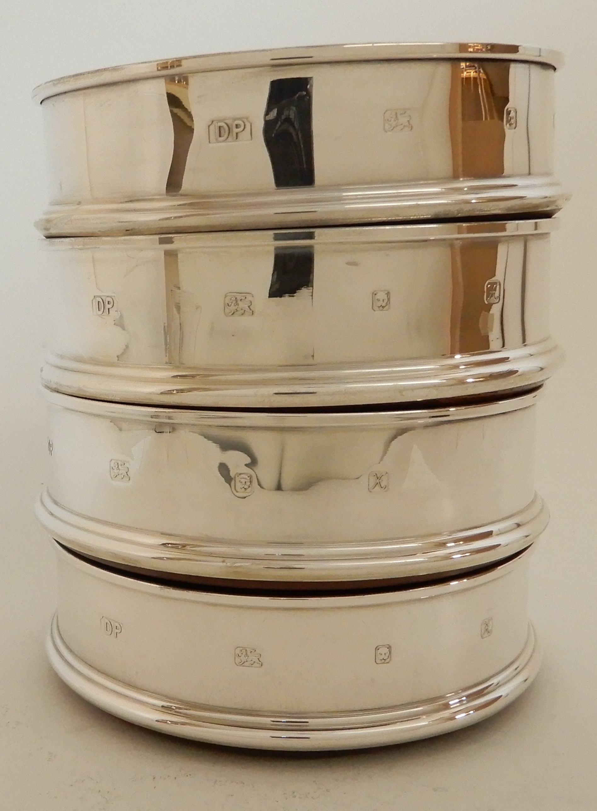 Lot 167 - A SET OF FOUR SILVER WINE COASTERS by Douglas Pell Silverware, London 1997, of plain circular form