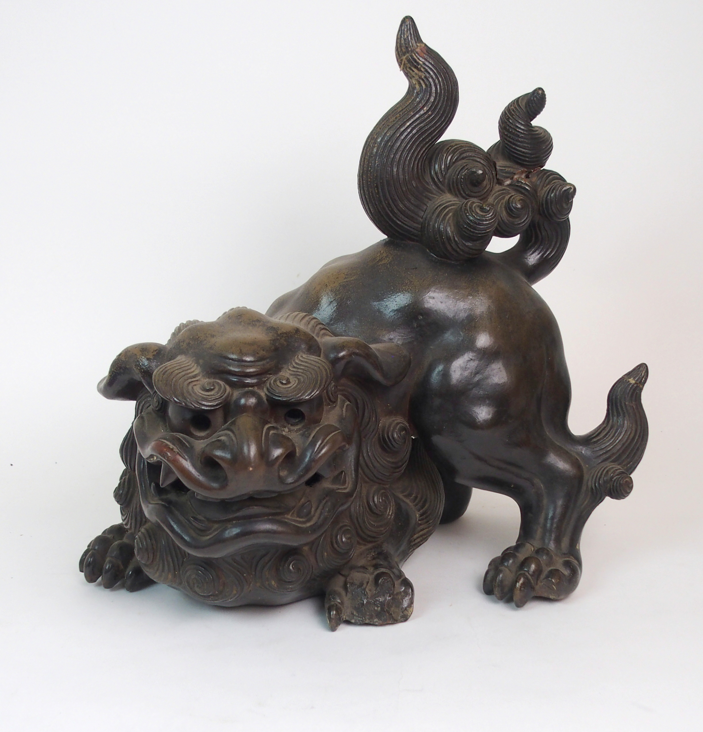 Lot 50 - A LARGE CHINESE PAINTED TERRACOTTA BUDDHISTIC LION modelled in aggressive stance with mouth roaring,