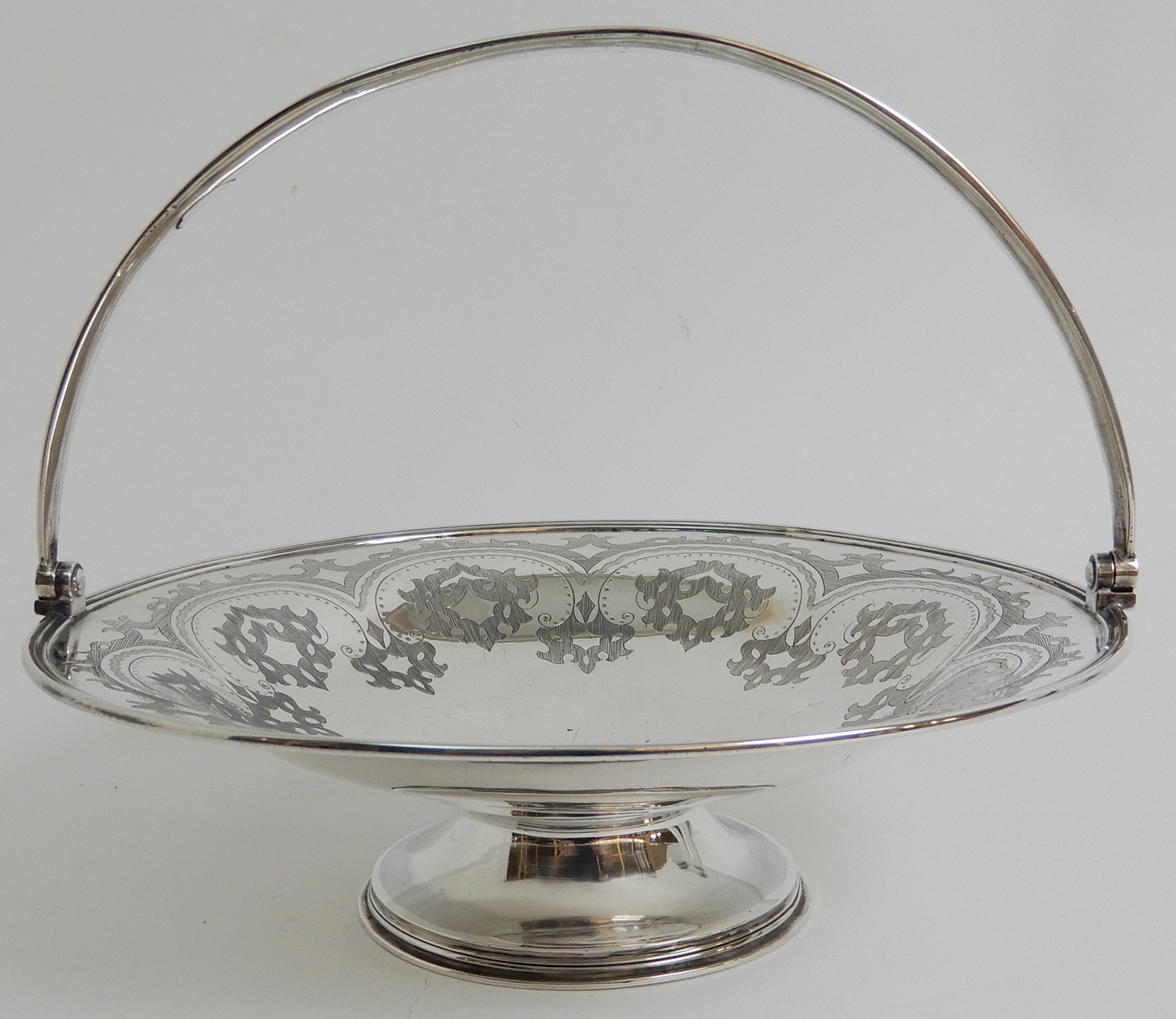 Lot 155 - A VICTORIAN SILVER SWING HANDLED BASKET by Robert Harper, London 1869, of circular form with