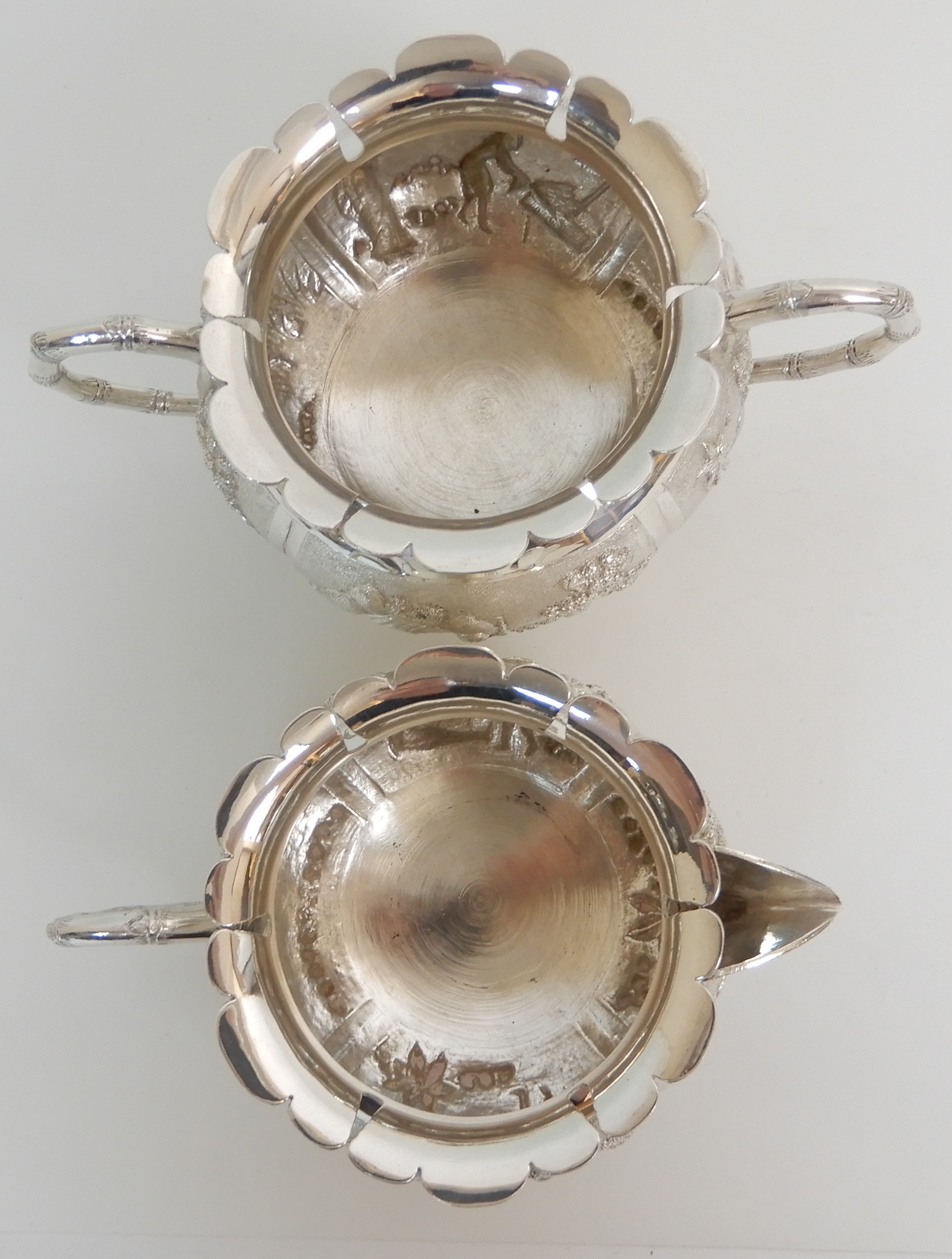 Lot 134 - AN ASIAN, PROBABLY BURMESE THREE PIECE EXPORT SILVER TEA SERVICE (unmarked but tested silver) of