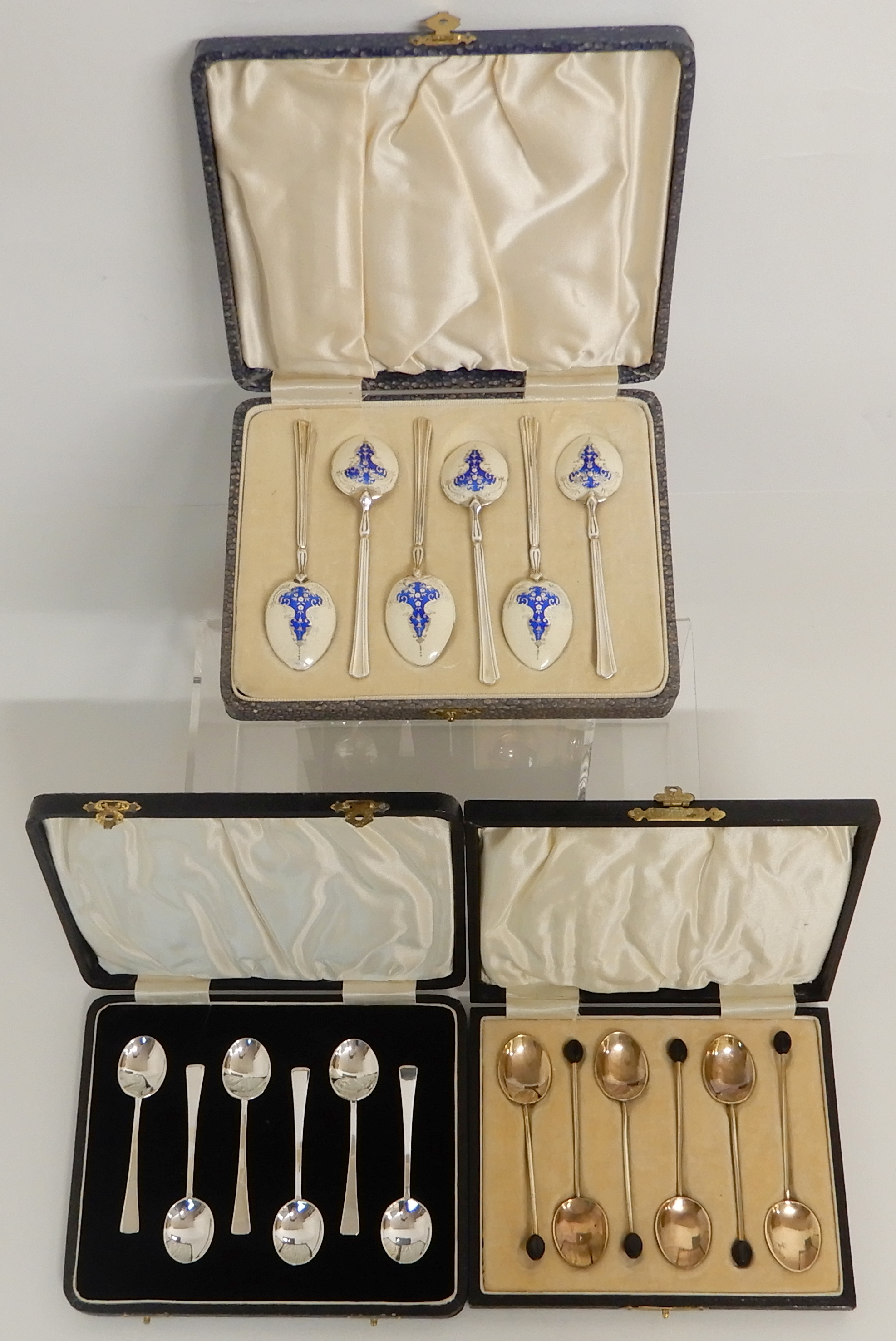 Lot 145 - A CASED SET OF SIX SILVER AND ENAMEL COFFEE SPOONS by Turner & Simpson Limited, Birmingham 1935, the