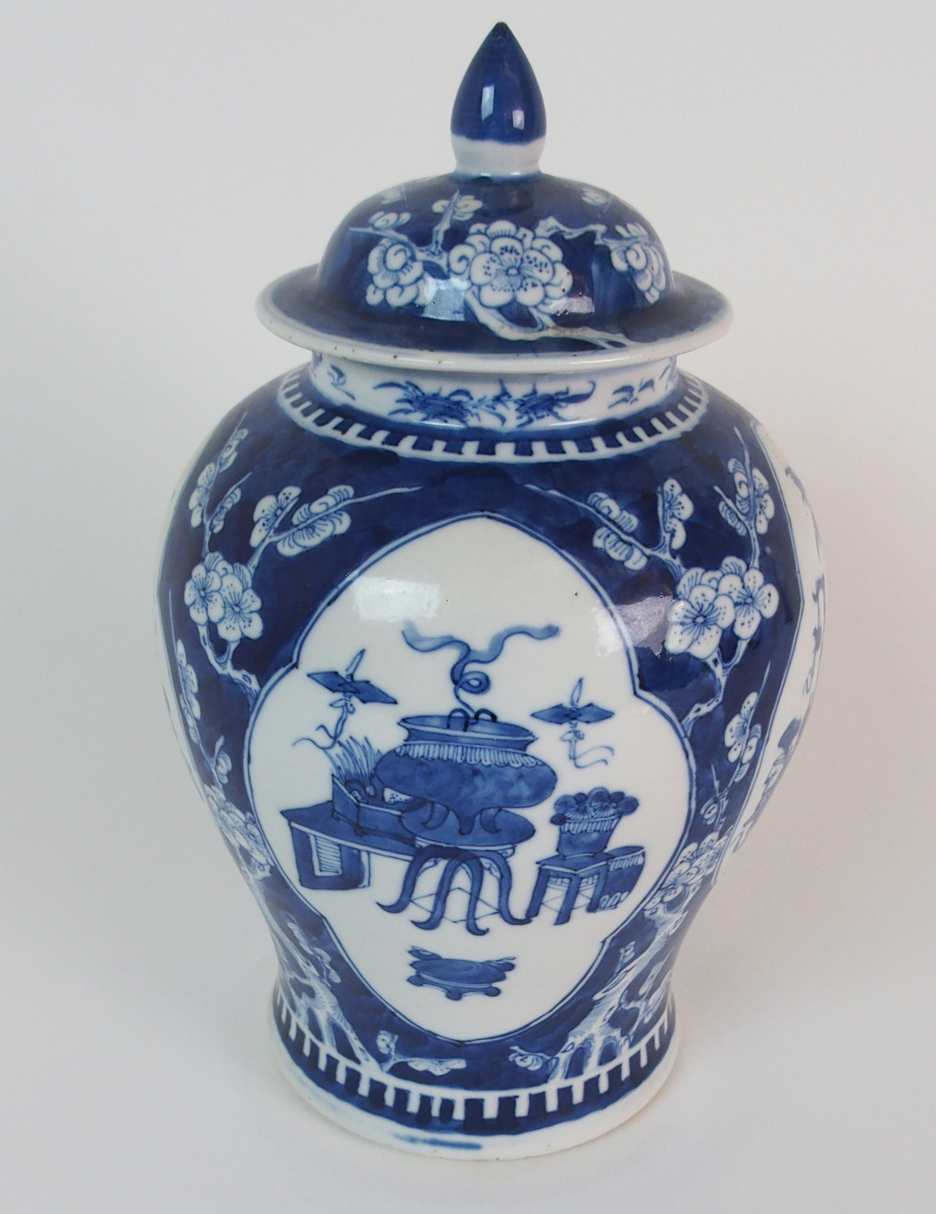 Lot 58 - A CHINESE BLUE AND WHITE BALUSTER VASE AND COVER painted with panels of precious objects divided