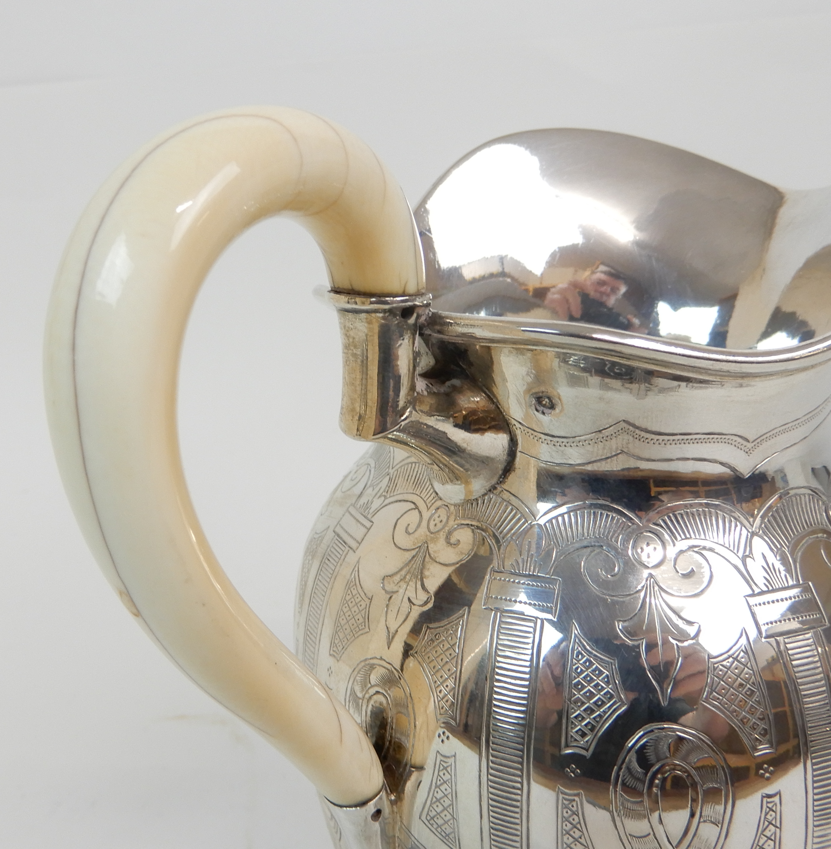 Lot 120 - A TWO PIECE VIENNESE 800 SILVER CAFE AU LAIT SET maker's marks PD, Vienna 1867 - 1922, of ovoid form