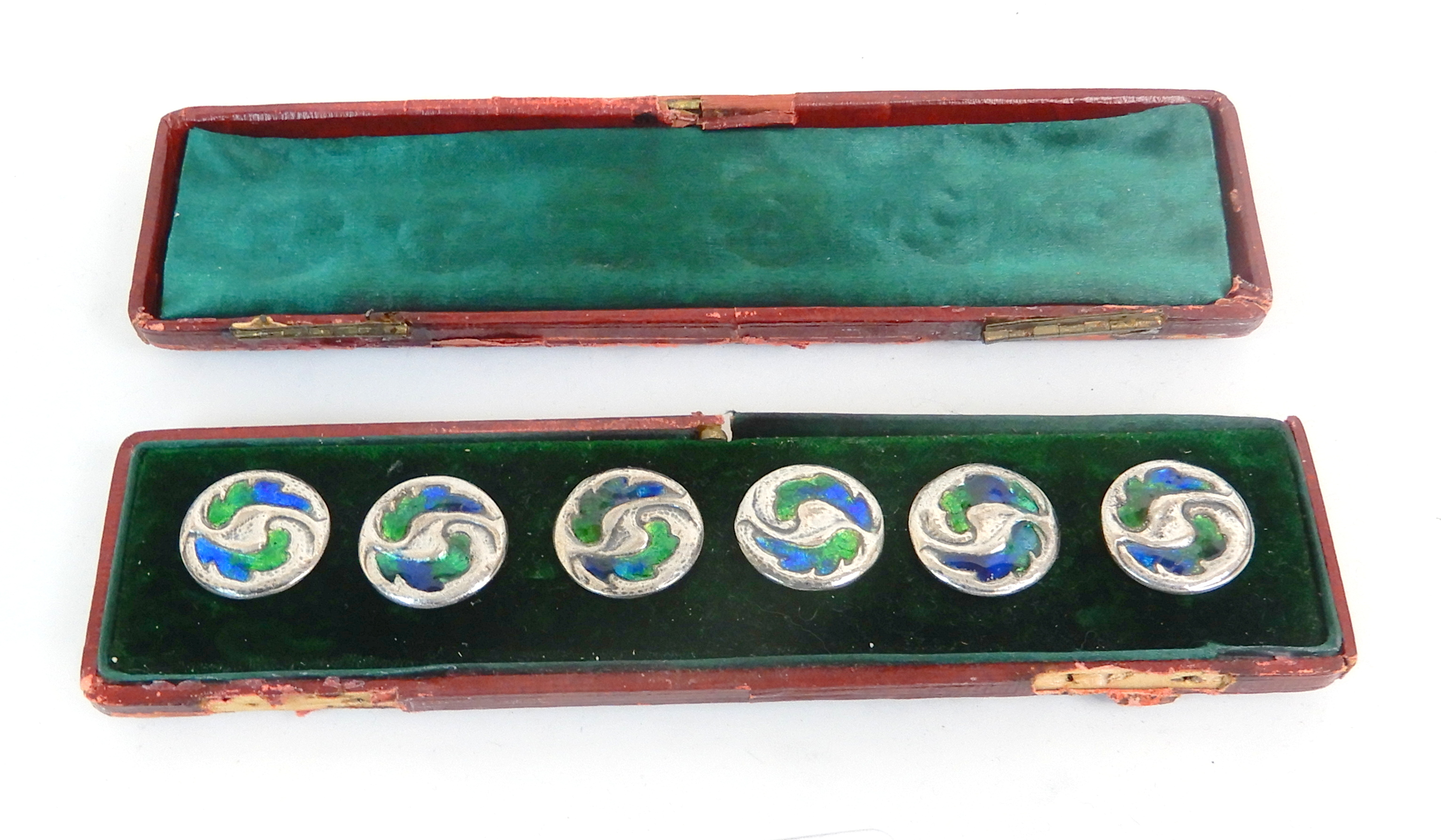 Lot 133 - A CASED SET OF SIX ARTS AND CRAFTS SILVER AND ENAMEL BUTTONS by William Hair Haseler, Birmingham