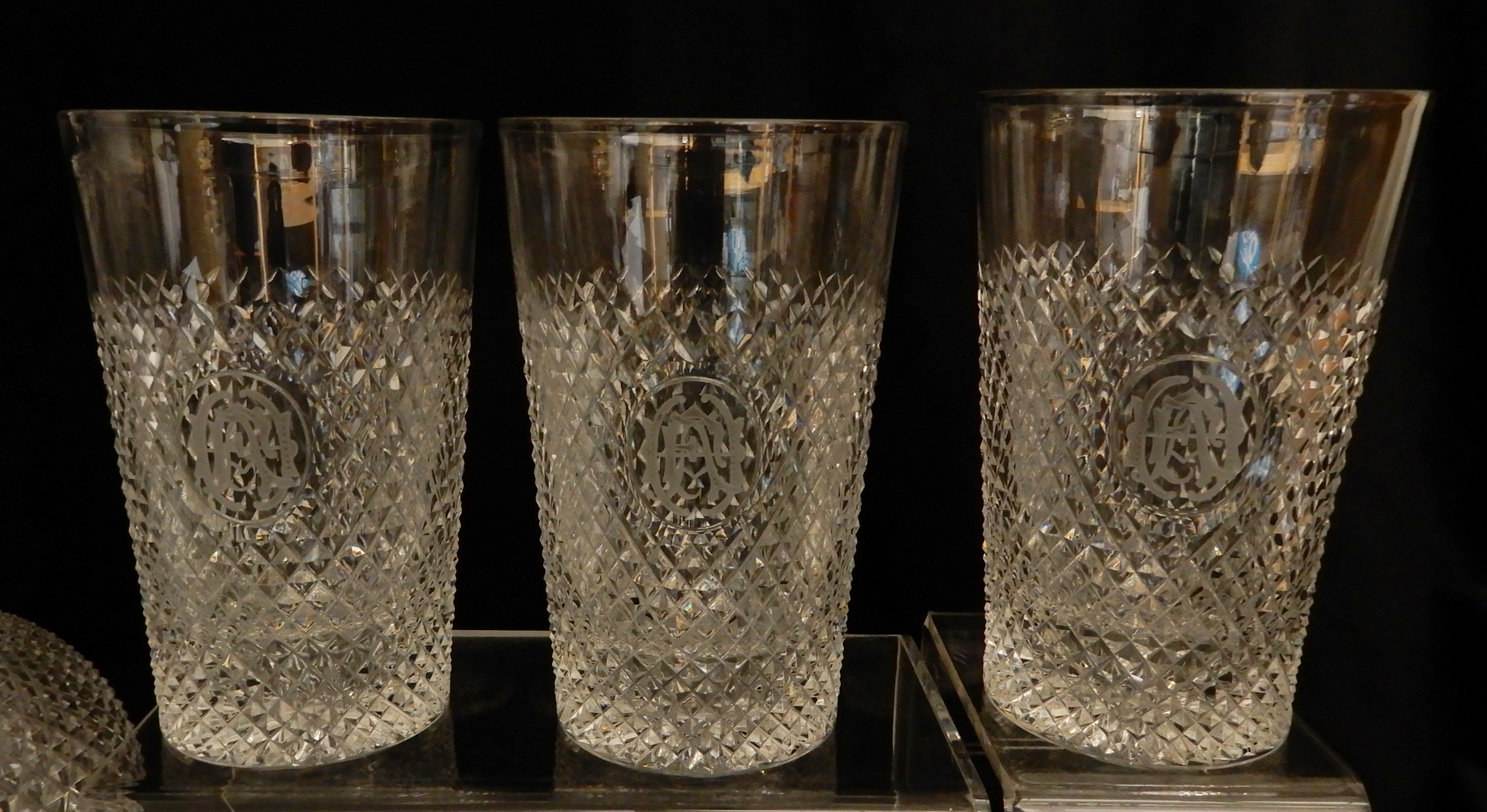 Lot 476 - A SUITE OF LATE 19TH CENTURY DIAMOND CUT CRYSTAL comprising six large tumblers, 14.5cm high, fifteen
