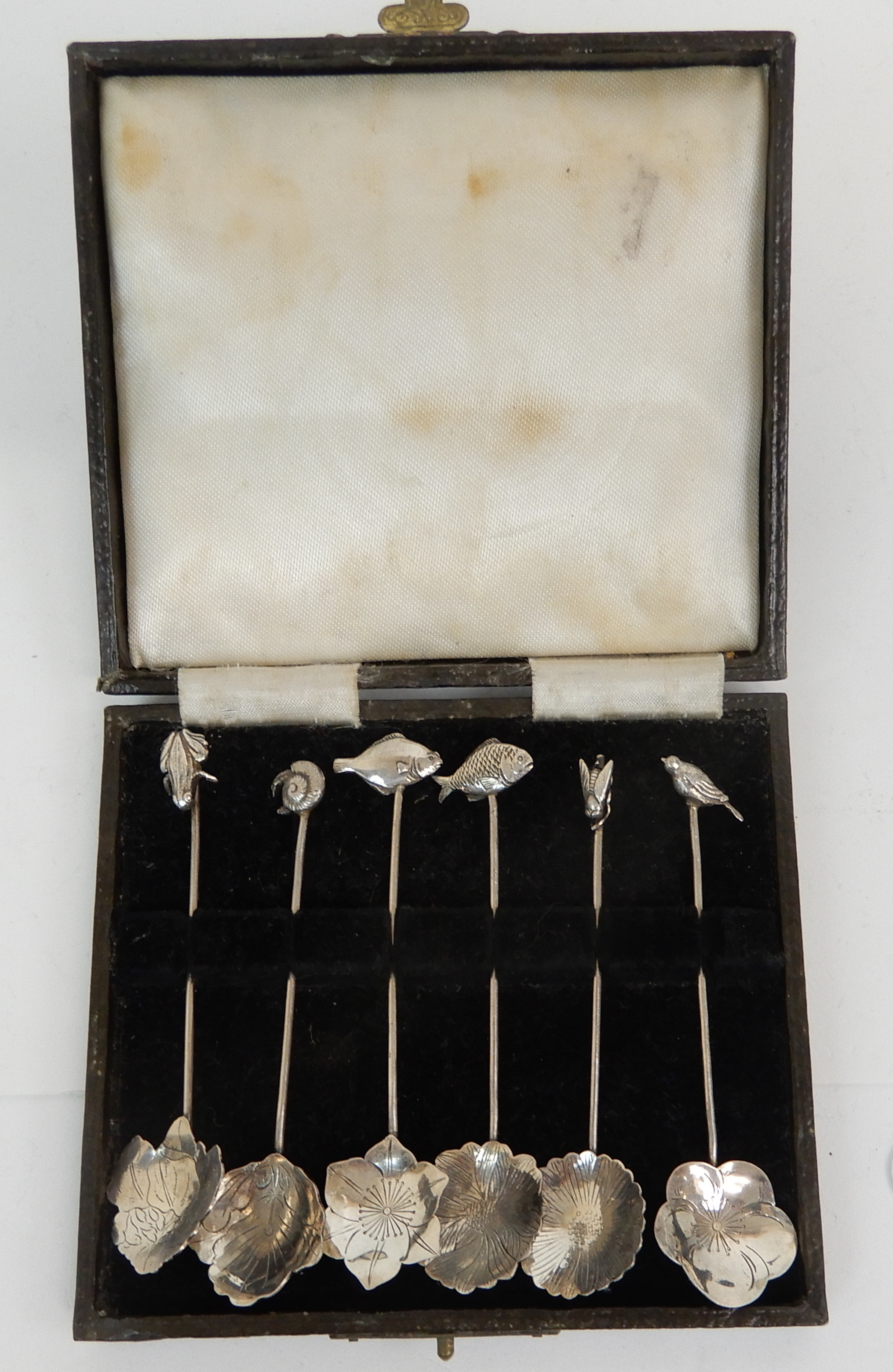 Lot 123 - A CASED SET OF SIX NOVELTY SILVER COFFEE SPOONS by Liberty & Company, London 1897, the bowls