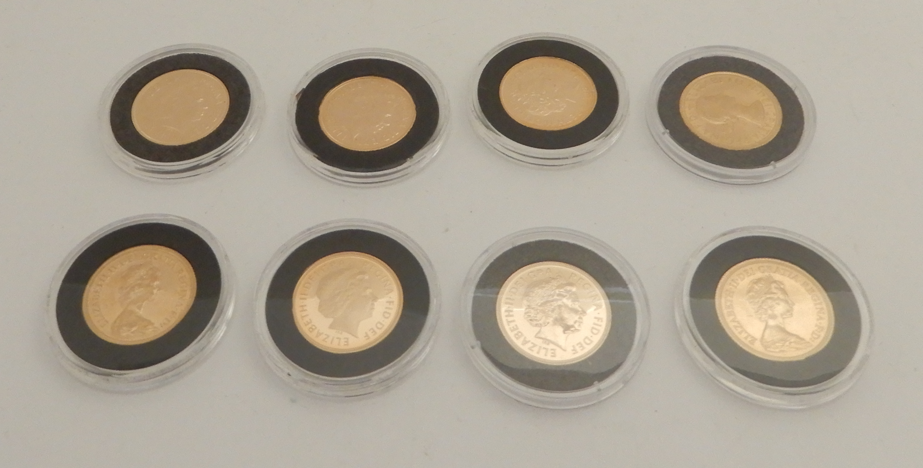 Lot 197 - EIGHT QUEEN ELIZABETH II GOLD FULL SOVEREIGNS (ENCAPSULATED) 1968, 1979 (2), 2002 (2), 2003, 2005 (