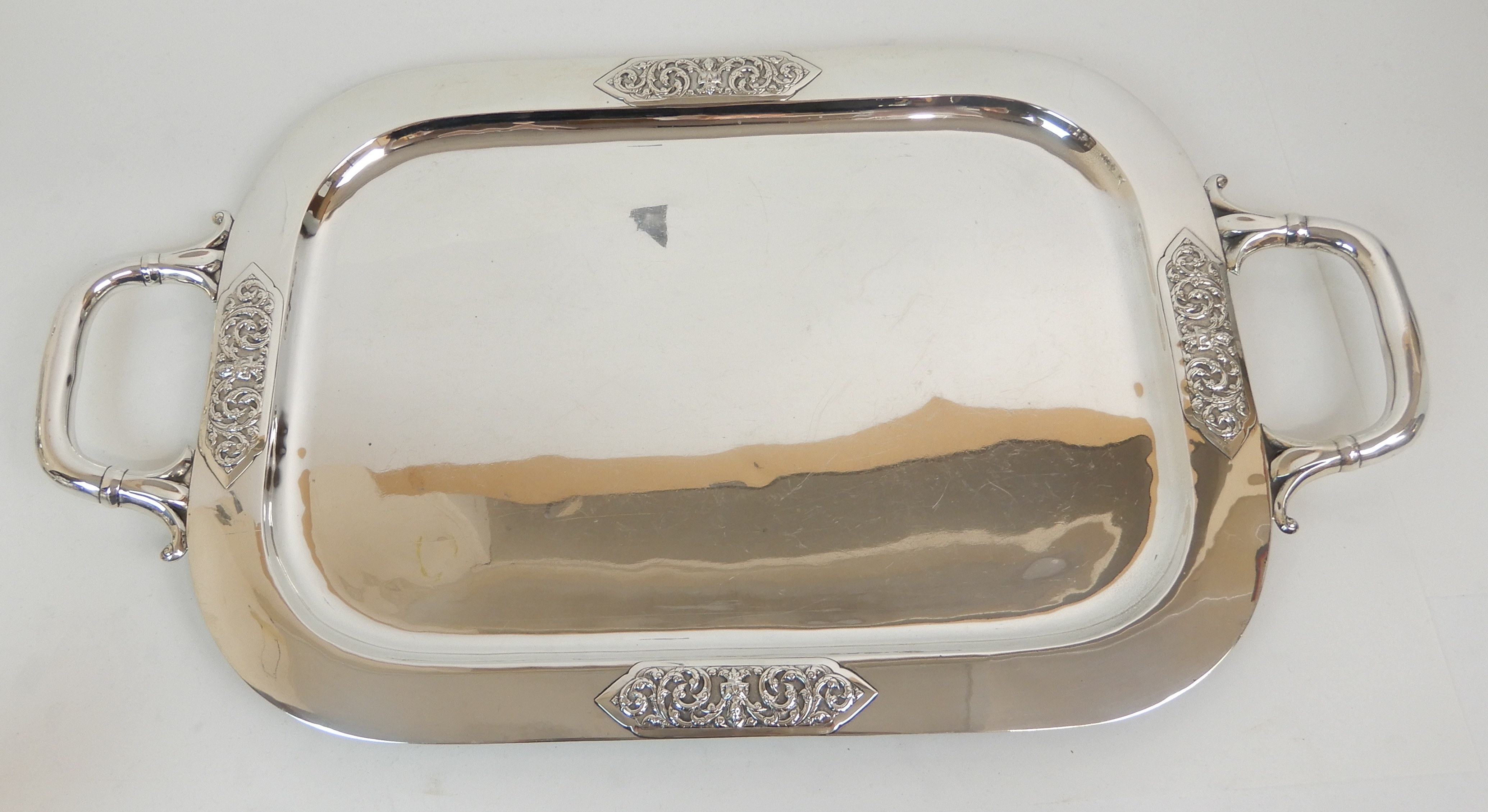 Lot 132 - A FOUR PIECE EASTERN SILVER TEA AND COFFEE SERVICE marked Thailand sterling, circa 1920, of tapering