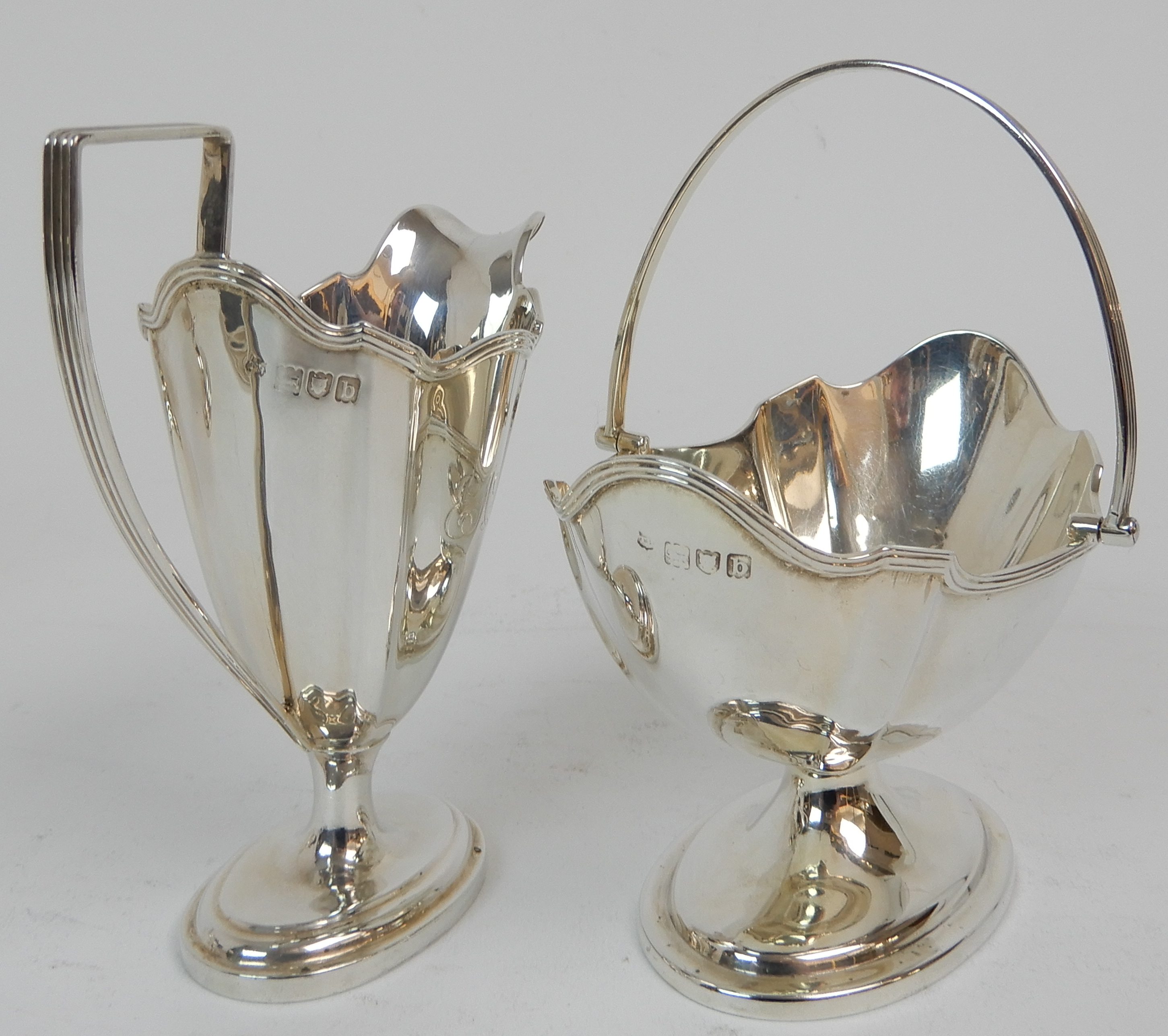 Lot 157 - A LATE VICTORIAN FOUR PIECE SILVER TEA SERVICE by Thomas Bradsbury & Sons, London 1897 comprising;