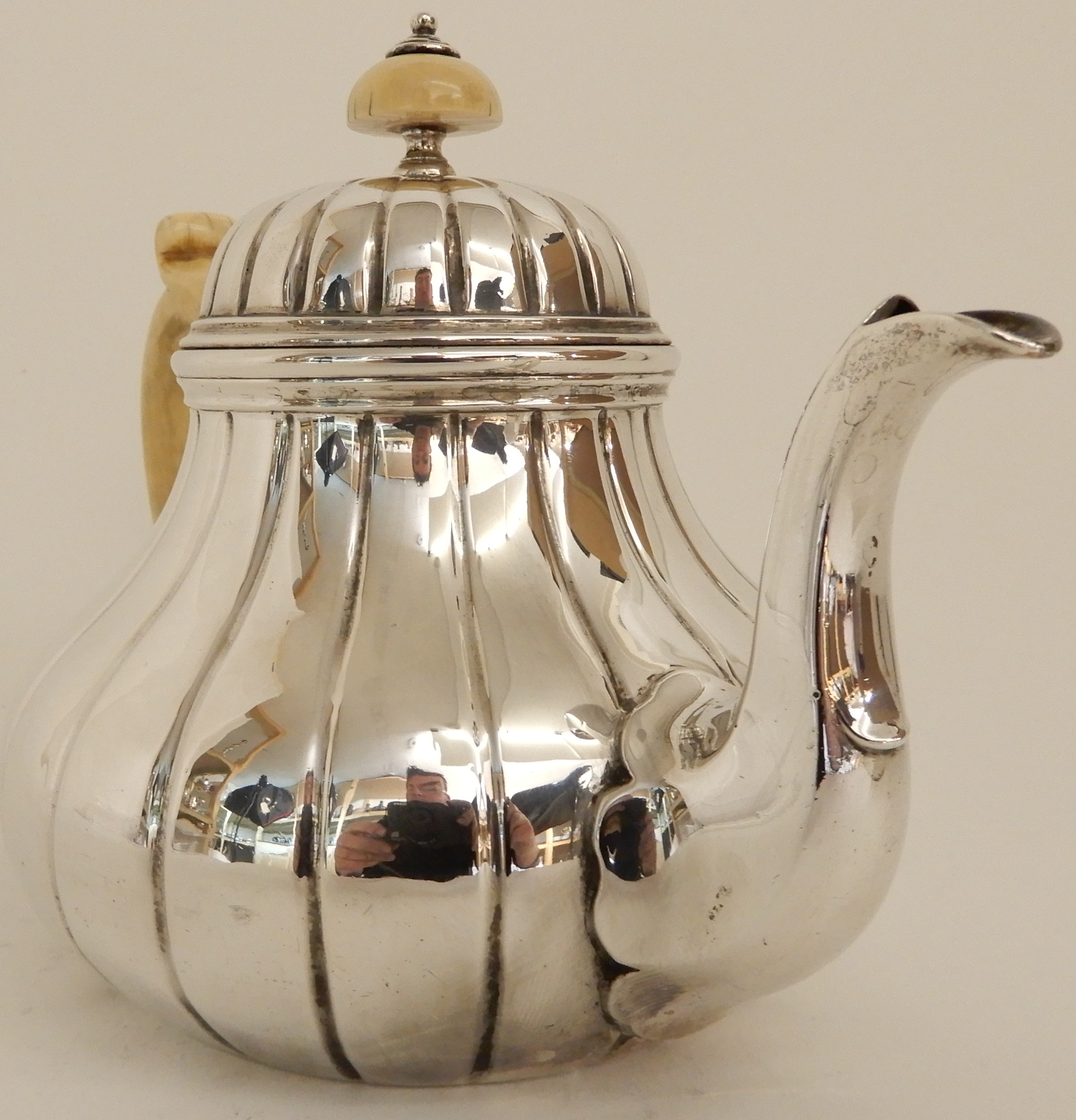 Lot 164 - A VICTORIAN SILVER TEAPOT by Robert Garrard, London 1855, of bulbous baluster form with ribbed body,