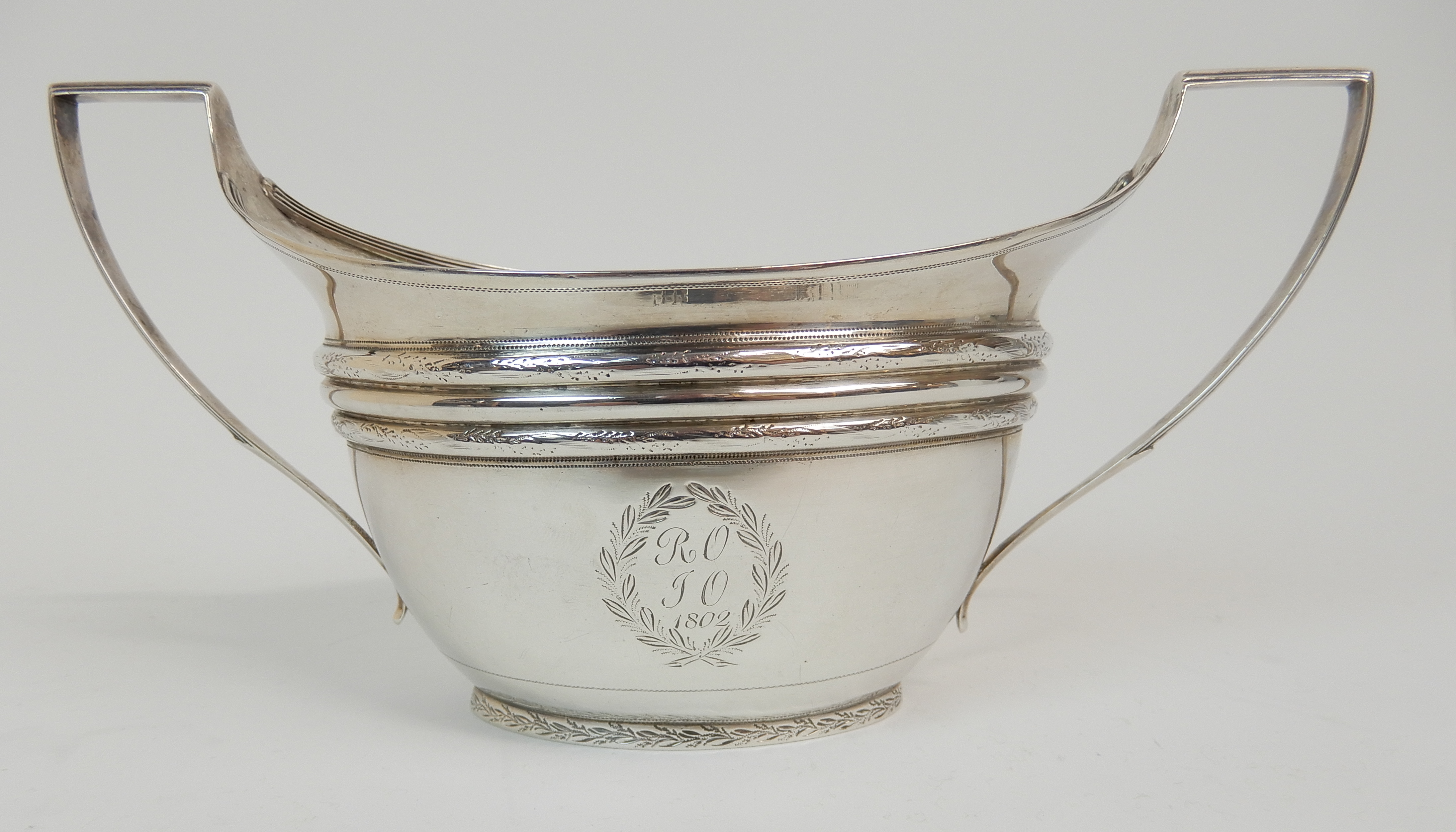 Lot 125 - A GEORGE III SILVER FOUR PIECE TEA SERVICE maker's marks JD, Edinburgh 1802, comprising teapot
