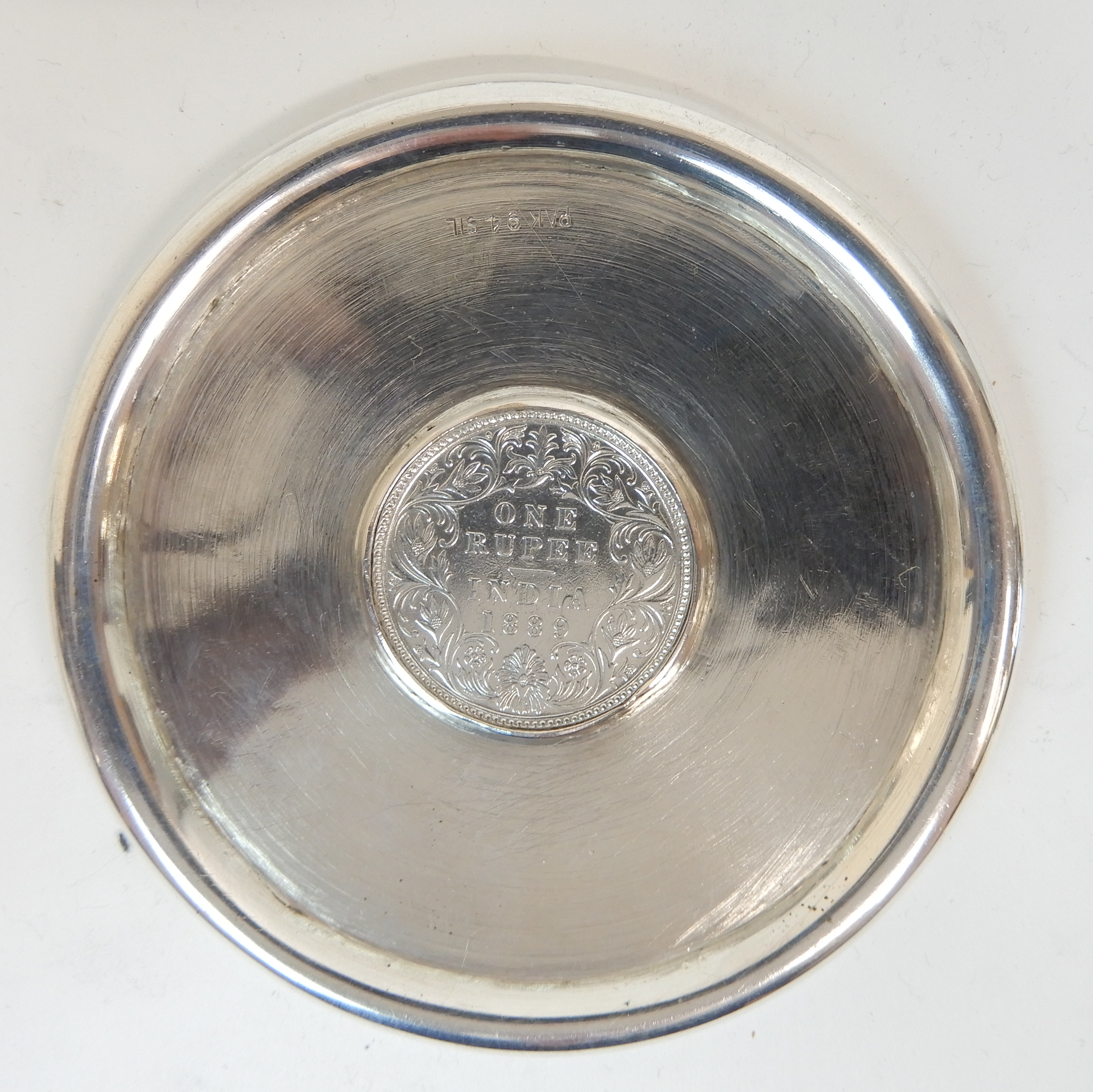 Lot 131 - A SET OF EIGHT EASTERN SILVER COASTERS marked PAK 94 SIL., of circular form with raised edge, each