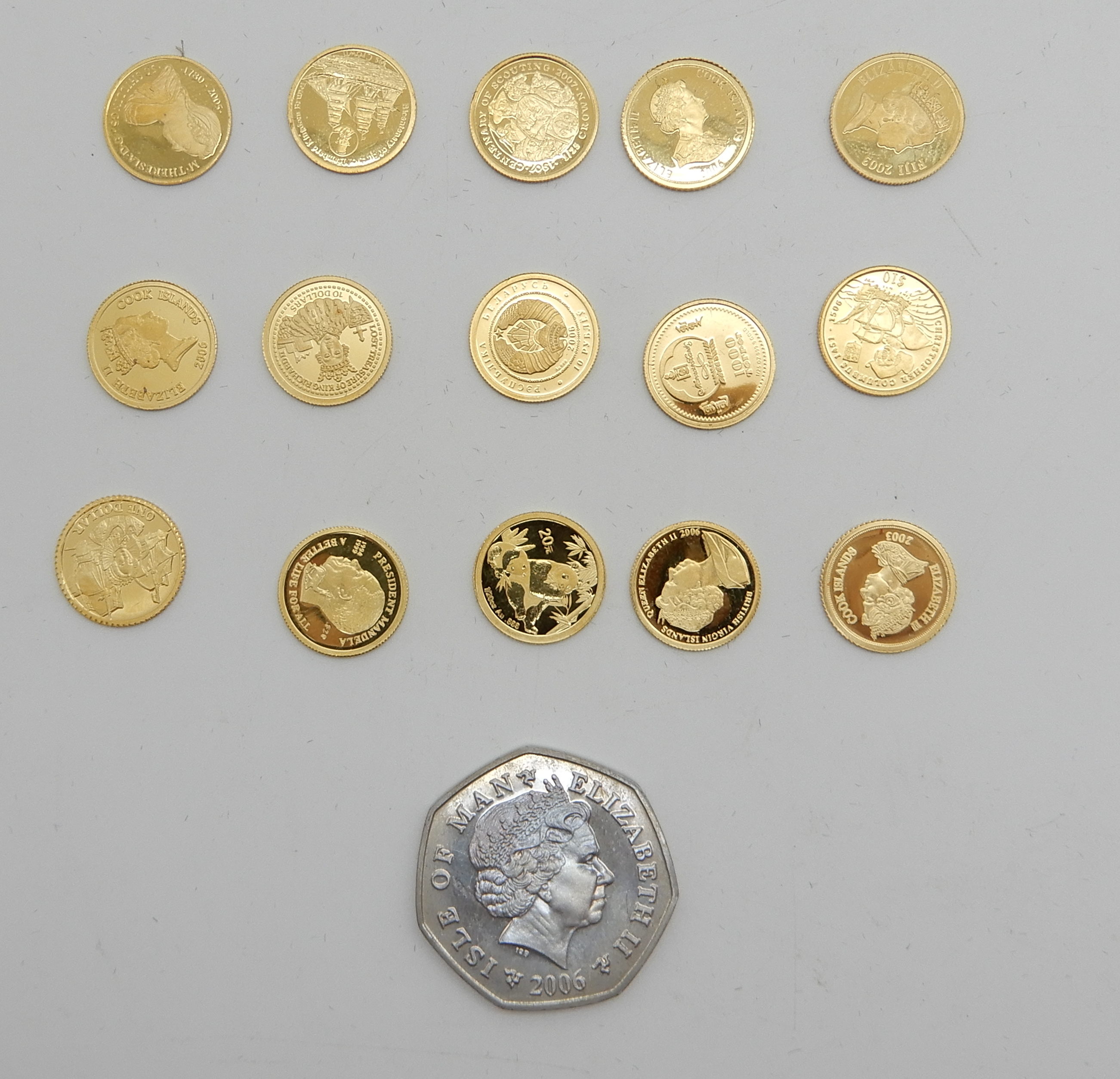 Lot 195 - FIFTEEN ASSORTED MINIATURE FINE GOLD COINS each 1.2gms approx with an Isle of Man Christmas 2006