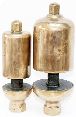 Great Western Railway locomotive whistles, a pair of large and small. Both have their top nuts