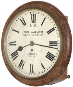 Southern Railway 12 inch oak cased fusee dial clock with wire driven movement. The original dial