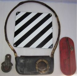 A lot containing signalling interest. A used leather token pouch. A signal wire pulley marked L&