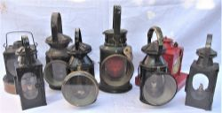 A Lot to include 8 x railway lamps of various designs and uses. Some missing parts and vessels.