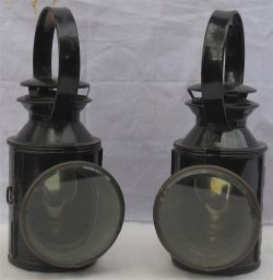 2 x London Transport railway hand lamps. Both complete and embossed LT on one side.